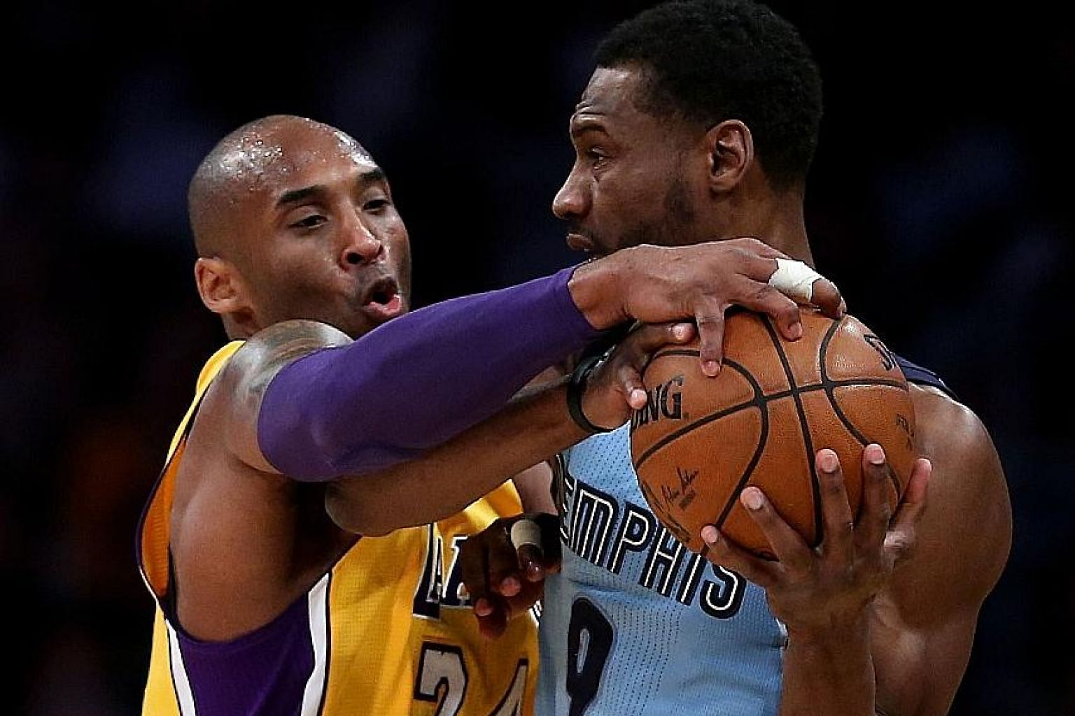 The Lakers' Kobe Bryant (No. 24) tussling for the ball with the Grizzlies' Tony Allen during their match at Staples Centre. The home side won 107-100 to end a four-game losing streak.