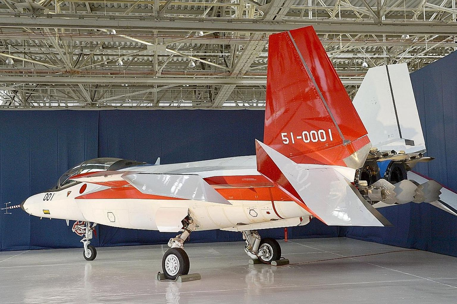 A prototype of the first Japan-made stealth fighter at a Mitsubishi Heavy Industries factory in Aichi prefecture. The ATD-X experimental aircraft is set to have its first test flights within days.