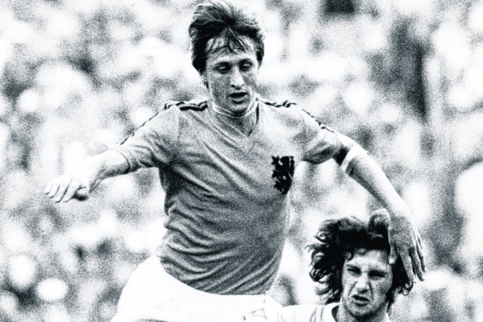 Johan Cruyff skipping past Fernando Morena during the Netherlands' 2-0 win over Uruguay in the 1974 World Cup in Hanover. The Dutch lost the final to hosts West Germany and again in the final four years later to hosts Argentina.