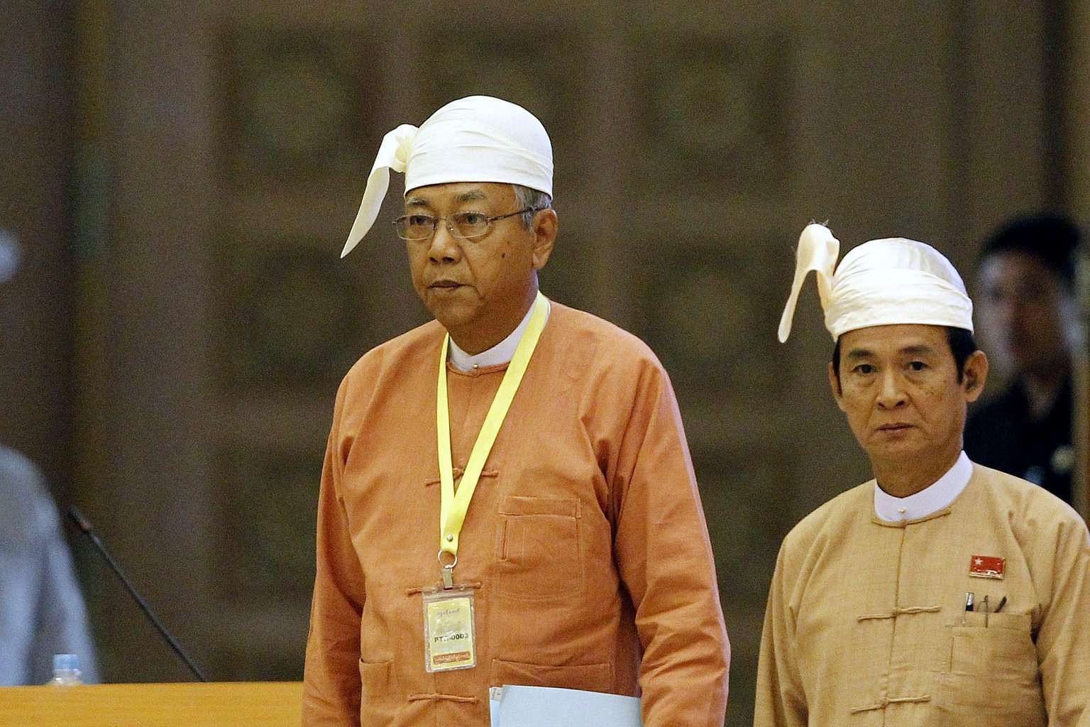 Newly elected Myanmar President Htin Kyaw (left) attending a parliamentary session in Naypyitaw on March 21.