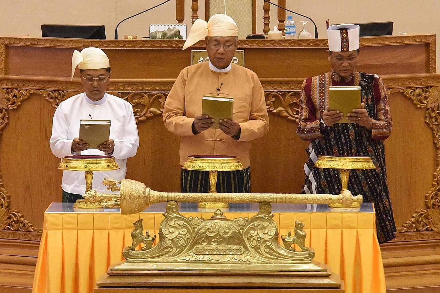 Myanmar's President Htin Kyaw (centre) flanked by his Vice-Presidents Myint Swe (left) and Henry Van Thio at yesterday's swearing-in ceremony.