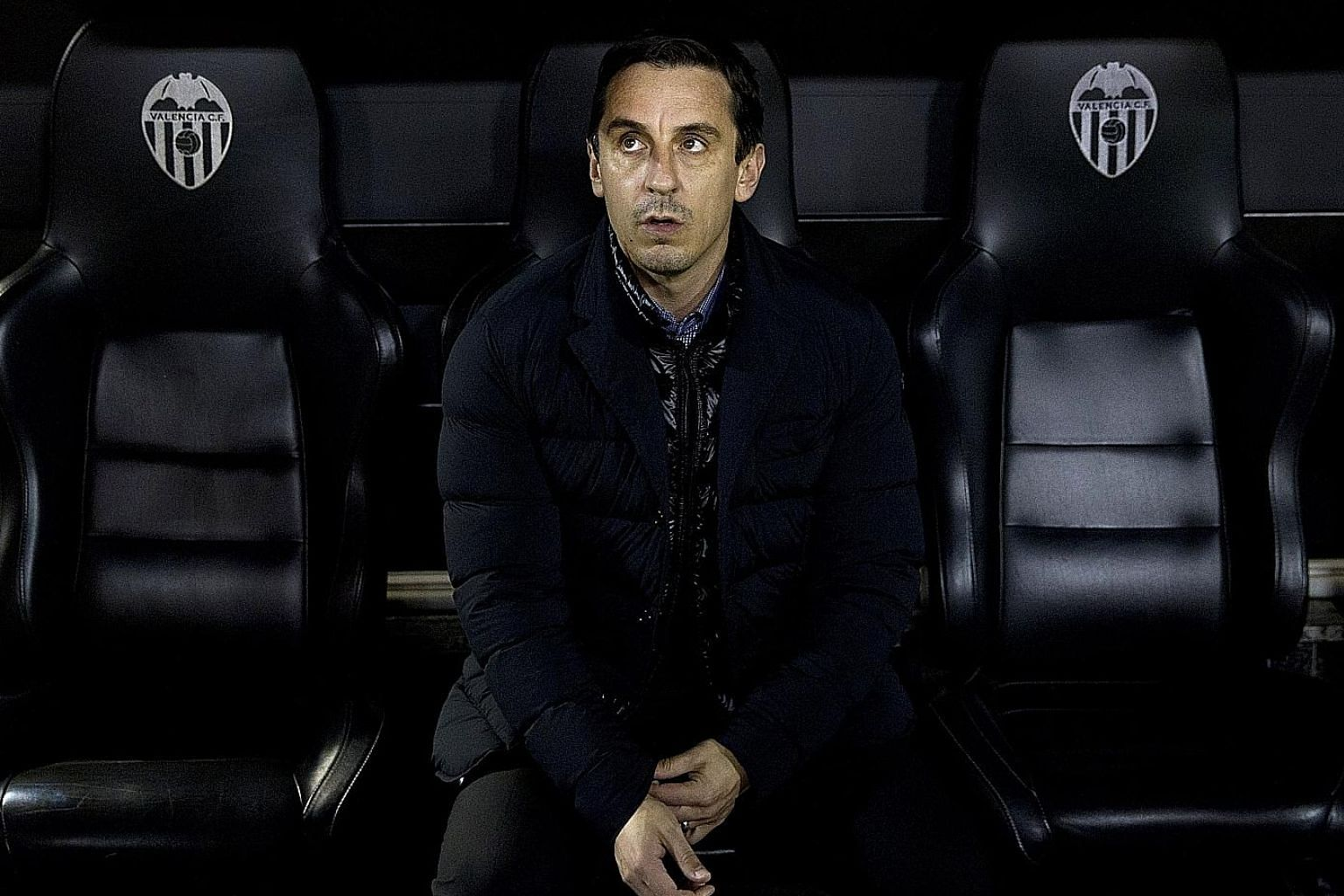 A forlorn-looking Gary Neville in the dug-out during the King's Cup semi-final second leg, where a 1-1 home draw saw Valencia thrashed 8-1 on aggregate by Barcelona.