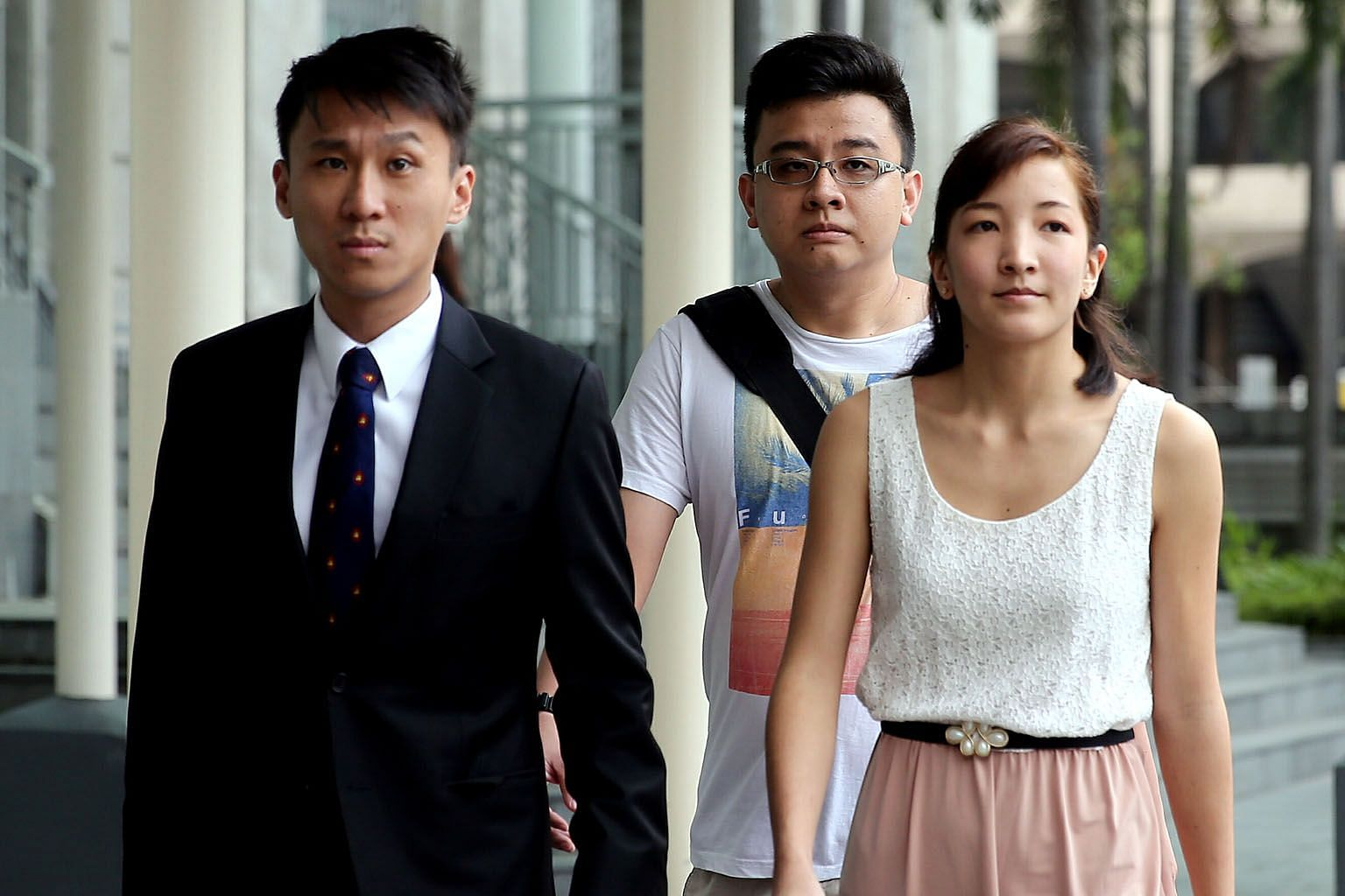 Ai Takagi, co-founder of erstwhile news website The Real Singapore (TRS), arriving at the State Courts last month with her husband Yang Kaiheng (centre), who allegedly helped to run the site, and lawyer Choo Zheng Xi. What the developments surrounding TRS