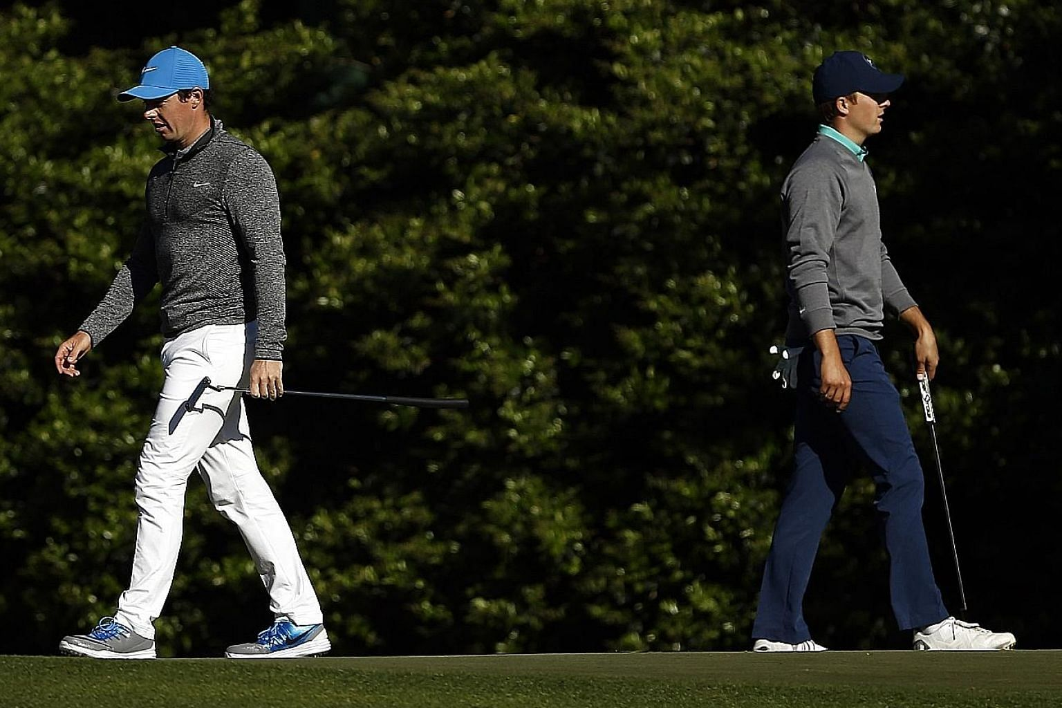 Northern Irishman Rory McIlroy (left) and American Jordan Spieth walk the 11th green during the third round of the Masters at Augusta National Golf Club.