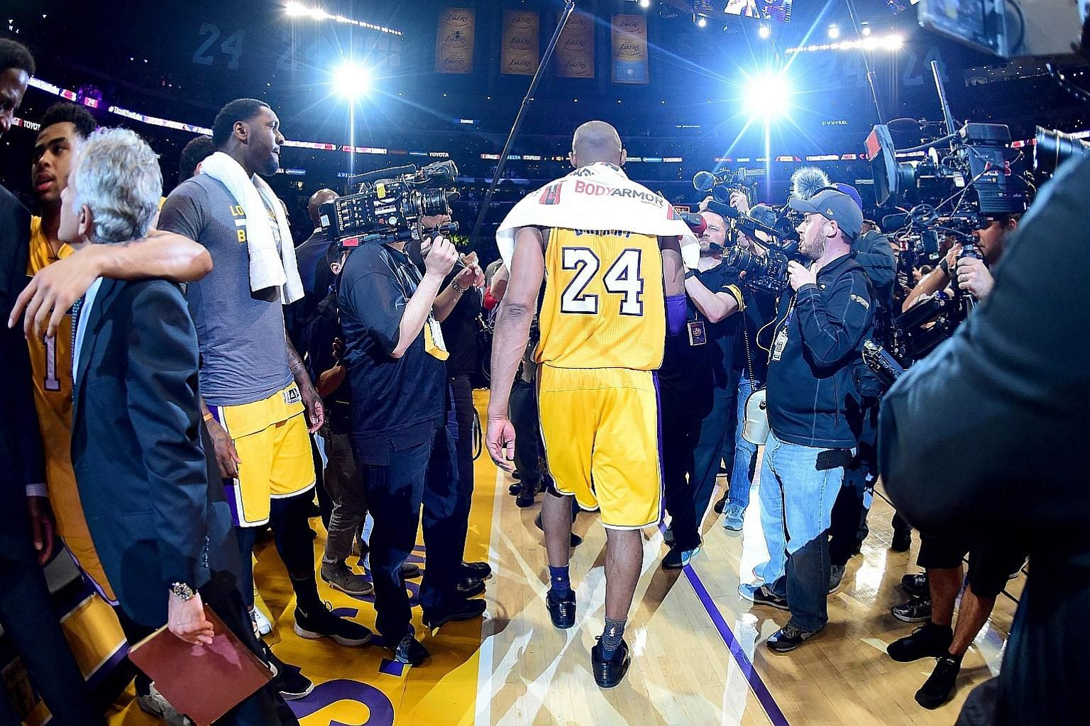 Kobe Bryant of the Los Angeles Lakers walks towards the tunnel for the last time in his 20-year NBA career after scoring 60 points in the tense 101-96 victory against the Utah Jazz on Wednesday.