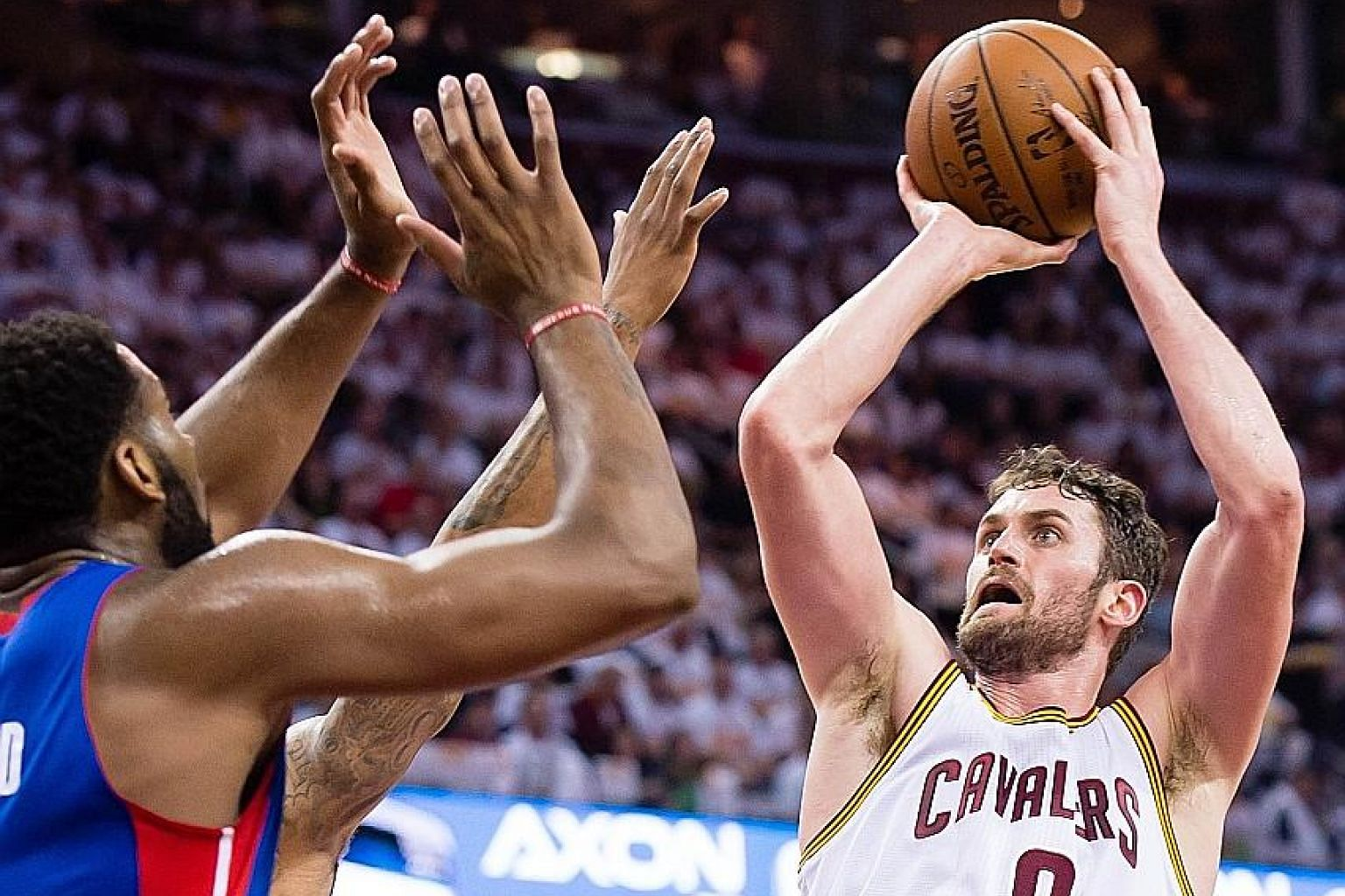 Cleveland's Kevin Love trying to shoot over Detroit players during the second half of Game 1 of the Eastern Conference first-round series at Quicken Loans Arena. The Cavaliers defeated the Pistons 106-101.