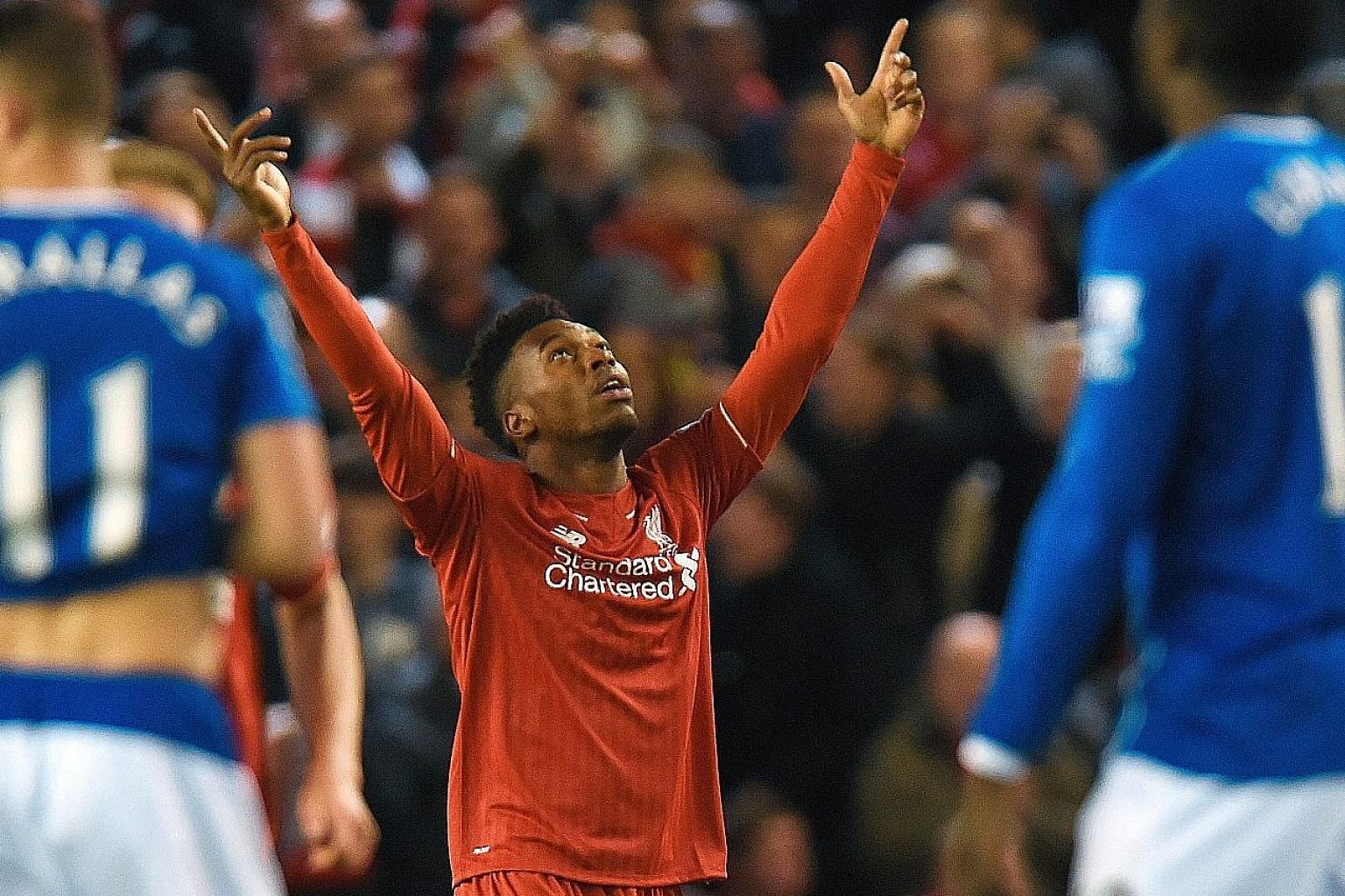 Daniel Sturridge celebrating after putting Liverpool three goals up against Everton. The Reds are on a rich run of form as Juergen Klopp's style starts to work magic.