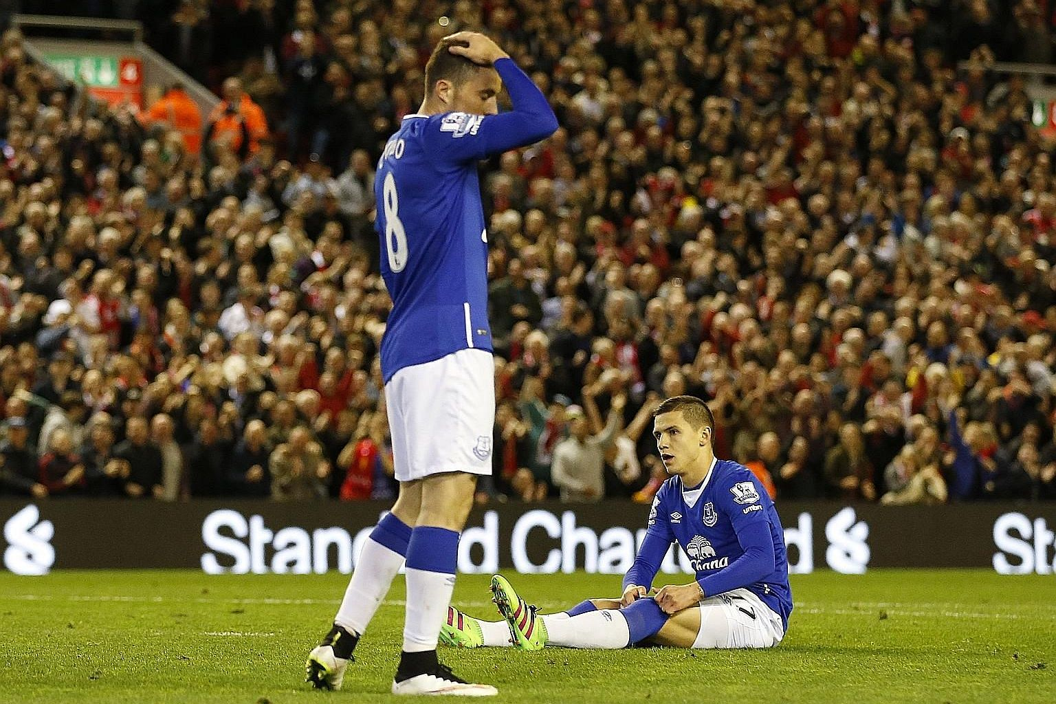 The pain is evident in the body language of Everton duo Muhamed Besic (sitting) and Bryan Oviedo after the 4-0 defeat at the hands of Liverpool on Wednesday. Roberto Martinez has challenged his side, suffering their worst season at home in the 138-ye