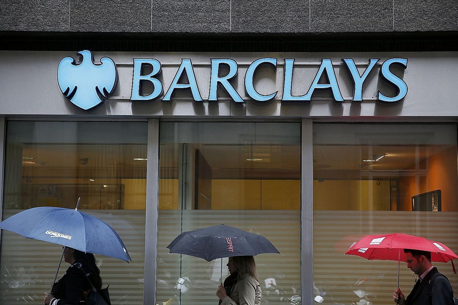 Barclays says revenue at its investment bank fell less than expected in turbulent markets, and it avoided any new misconduct charges.