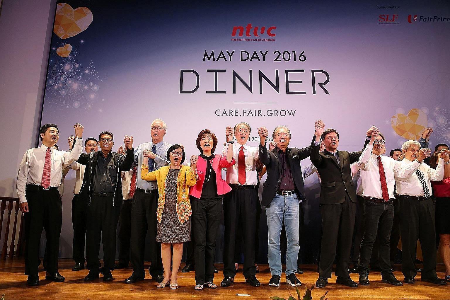 NTUC central committee members singing with (front row, from left) NTUC deputy secretary-general Heng Chee How, NTUC president emeritus John De Payva, Emeritus Senior Minister Goh Chok Tong, NTUC's first woman president Diana Chia, NTUC president Mar