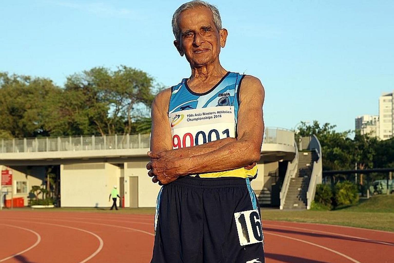 """Retired Indian naval commander V. Sriramulu at the Kallang practice track this week. He was the only competitor in the 5km race-walking event (for those 90 and older) in the Asia Masters on Wednesday. """"Better to live like a lion for a day, than a lam"""