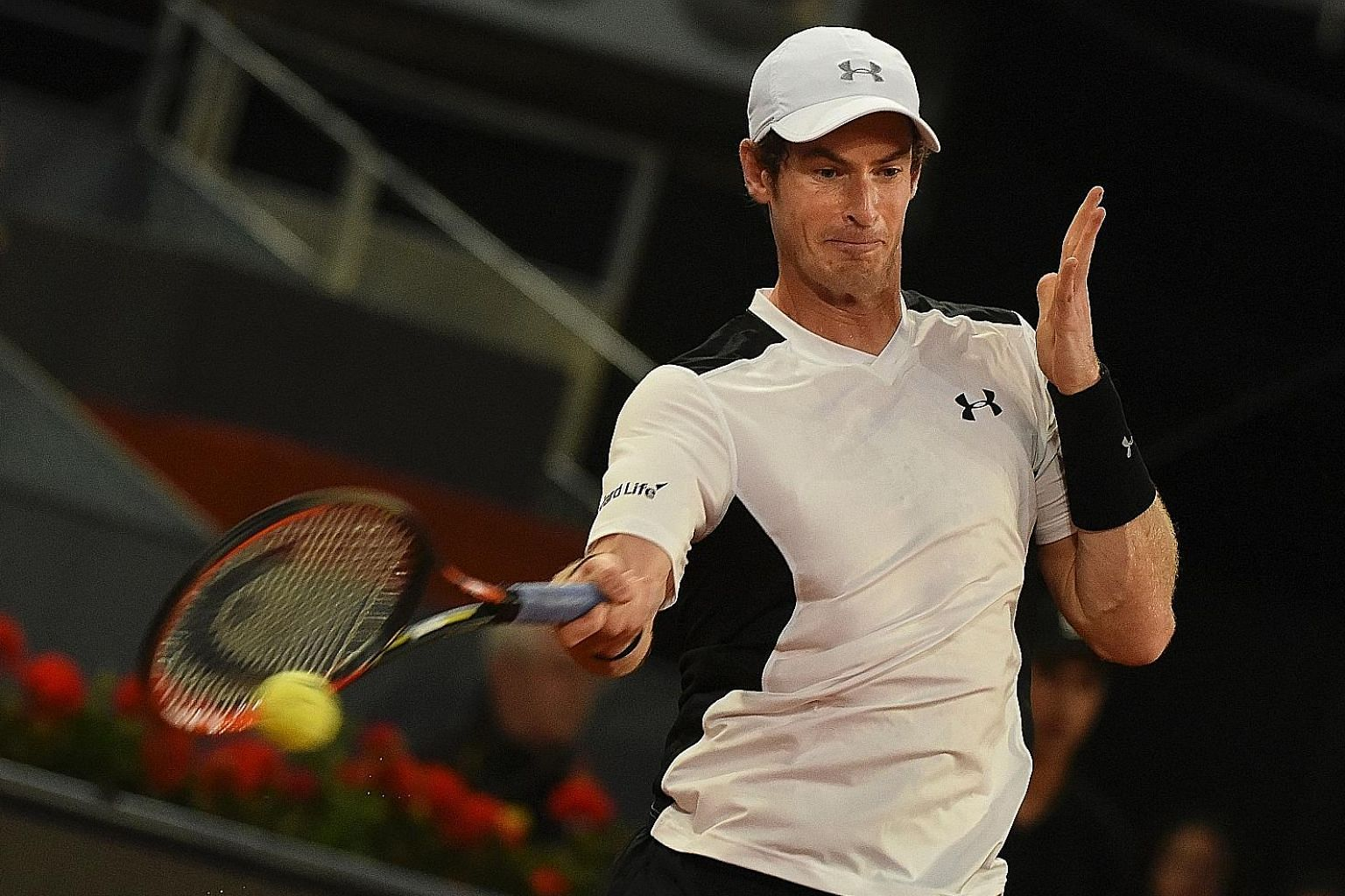 World No. 2 Andy Murray hits a forehand during his Madrid Open quarter-final win against Tomas Berdych yesterday. The Briton was most pleased with his second serve, which he believes has improved dramatically.