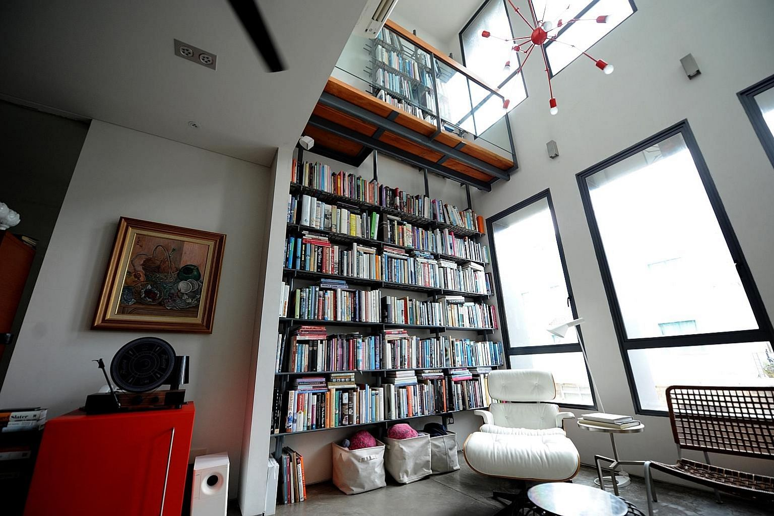 A 6m-high bookshelf is a prominent feature in the house of food blogger Aun Koh and his wife Tan Su-Lyn.