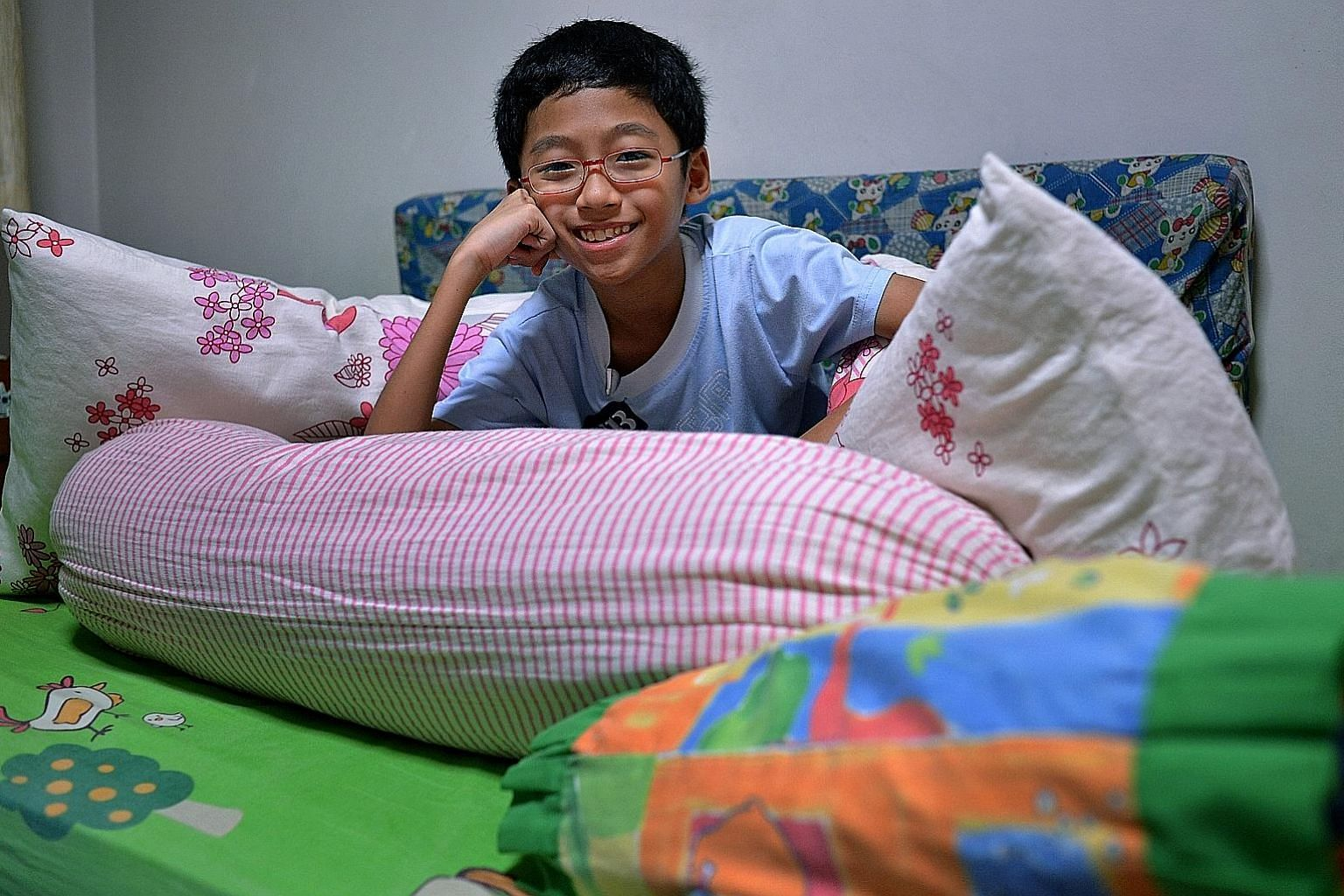 Kai Jun, 12, suffers from severe haemophilia, and his parents pad his room with extra mattresses and pillows to cushion him from any falls or bumps that could cause him to bleed.