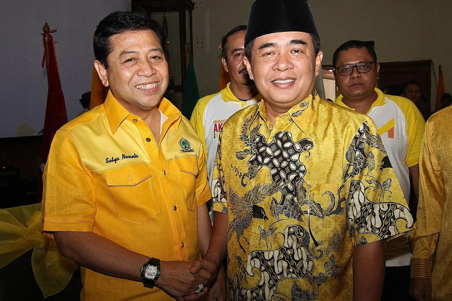 Mr Setya Novanto (at left) and House Speaker Ade Komarudin at the Golkar party headquarters in Jakarta last Saturday. Both men are among eight members campaigning for the post of Golkar chief, and experts see the contest as a straight fight between t
