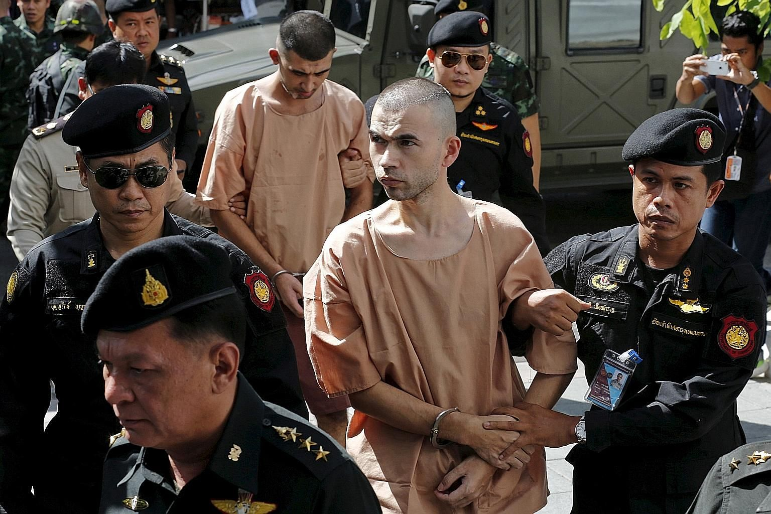 Adem Karadag (in front) and Yusufu Mieraili denied they were involved in last year's deadly Bangkok shrine bombing.