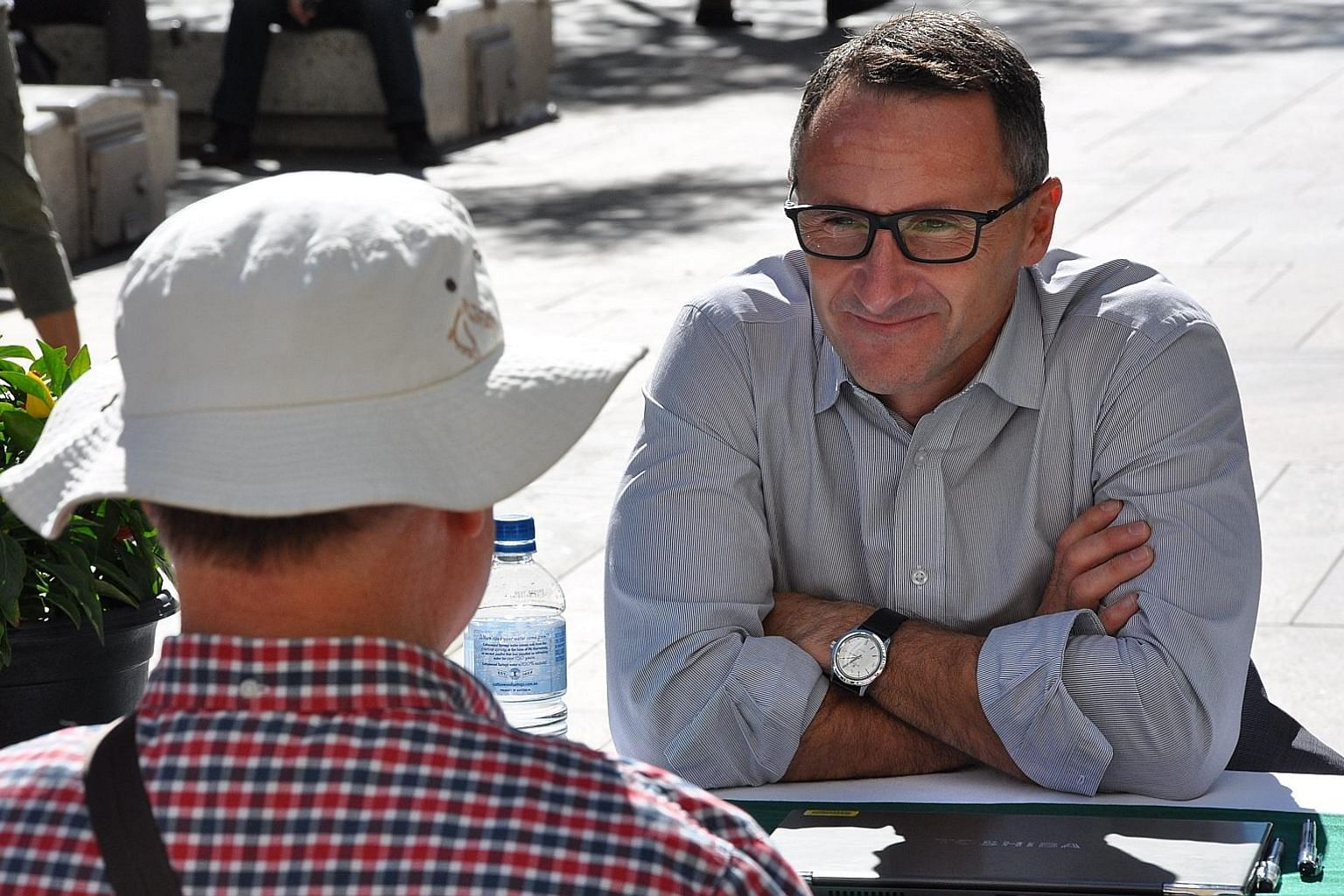 Dr Di Natale talking to a voter in Perth last week. The sports-obsessed farmer and former medical doctor has sought to give the Greens a fresh, modern image after becoming their leader last year.
