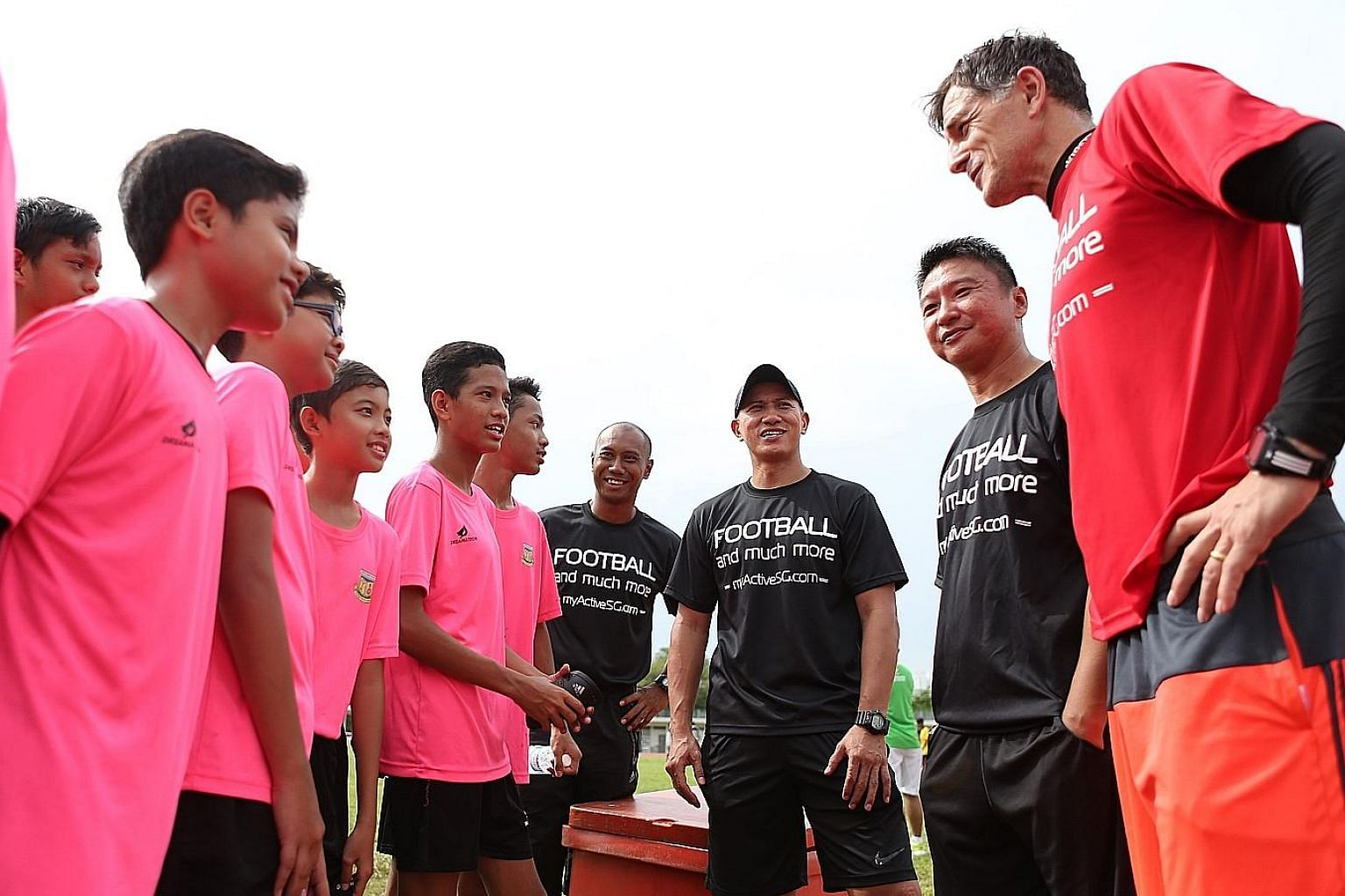 (From right) ActiveSG Football Academy principal Aleksandar Duric and head coaches Richard Bok, Robin Chitrakar and Hairil Amin talking to players from Juying Secondary. Duric says the programme aims to teach not only footballing tactics but also lif