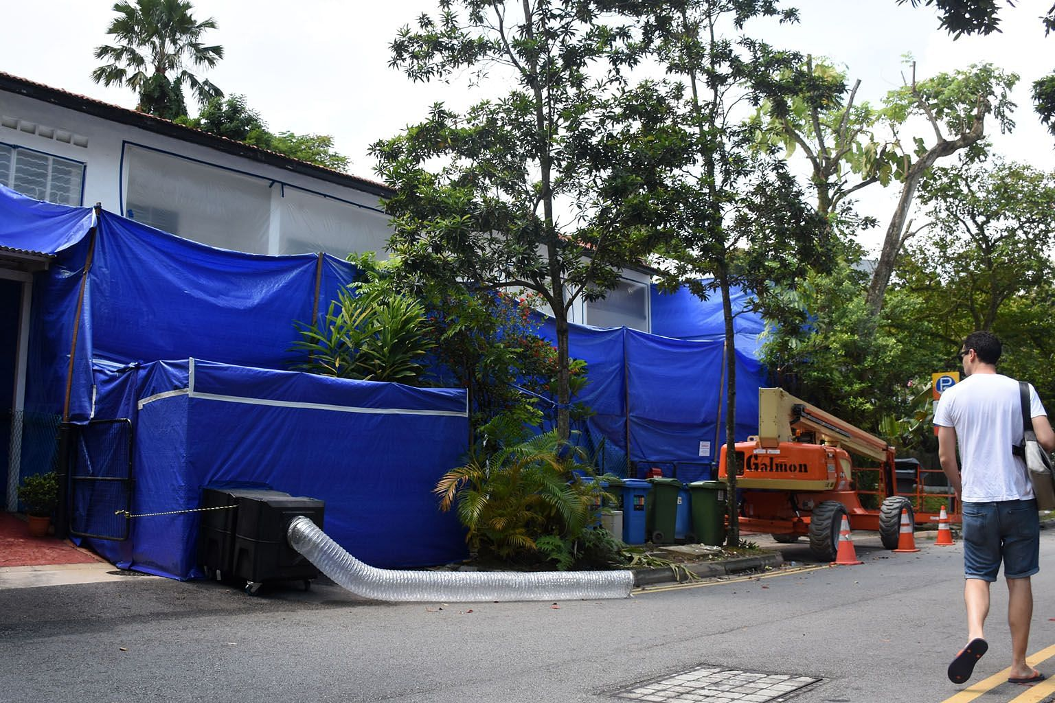 Three houses in Jalan Hitam Manis were enclosed in sheets for asbestos removal when The Straits Times visited Chip Bee Gardens last week.