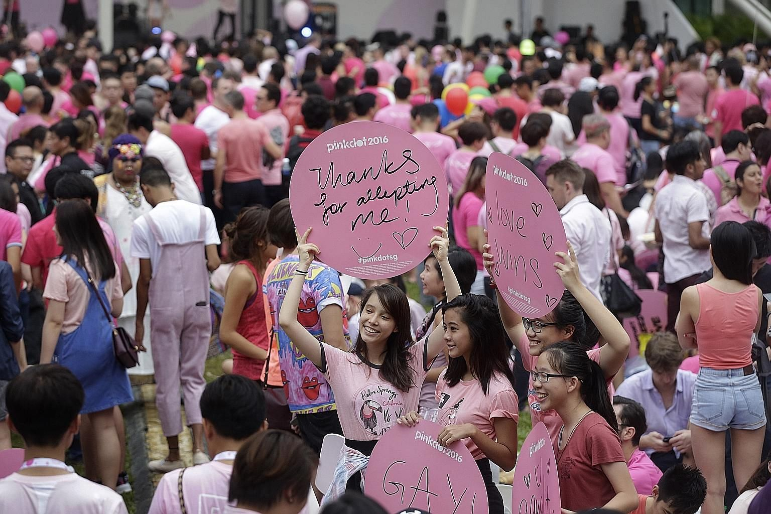 Participants during last Saturday's annual Pink Dot event at Speakers' Corner. This year's corporate sponsors included multinationals like Google as well as banks such as JP Morgan and Goldman Sachs.