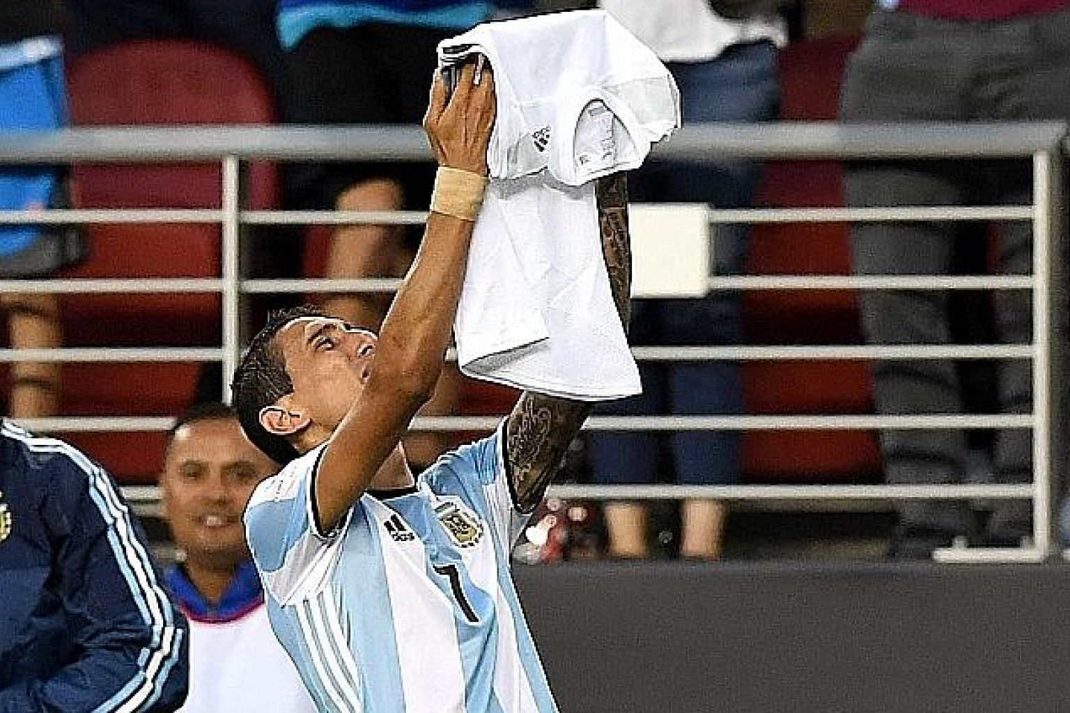 Angel di Maria paying tribute to his late grandmother after scoring Argentina's opening goal against Chile in their Copa America Centenario match in Santa Clara. The win avenged his team's penalty shoot-out loss to their rivals in last year's Copa fi