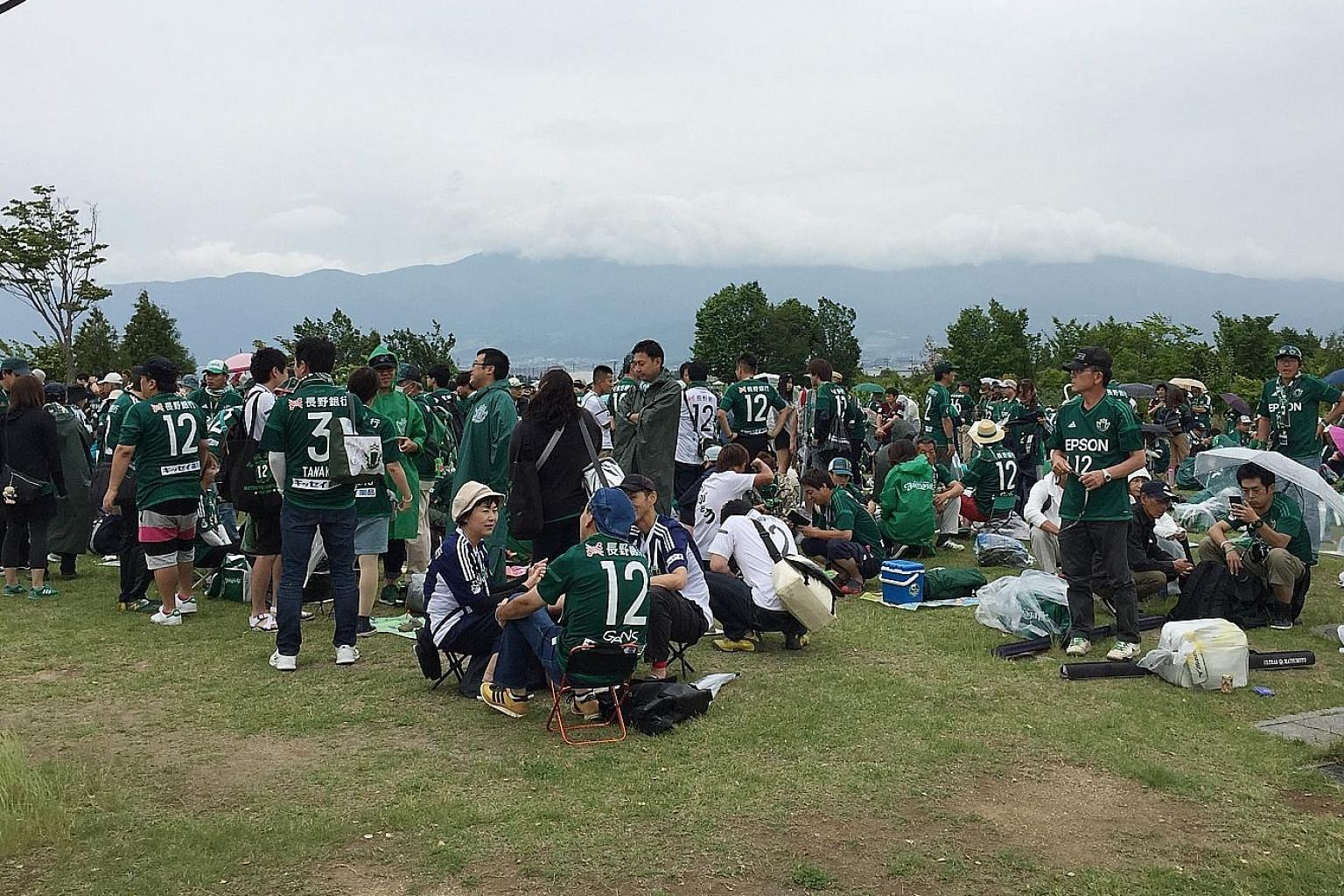 Fans gathering outside Matsumoto Yamaga's Alwin Stadium four hours before the home side kicked off their J2 tie. Yamaga want to return to Japanese football's heady heights, and are keen to knit the community together along the way.