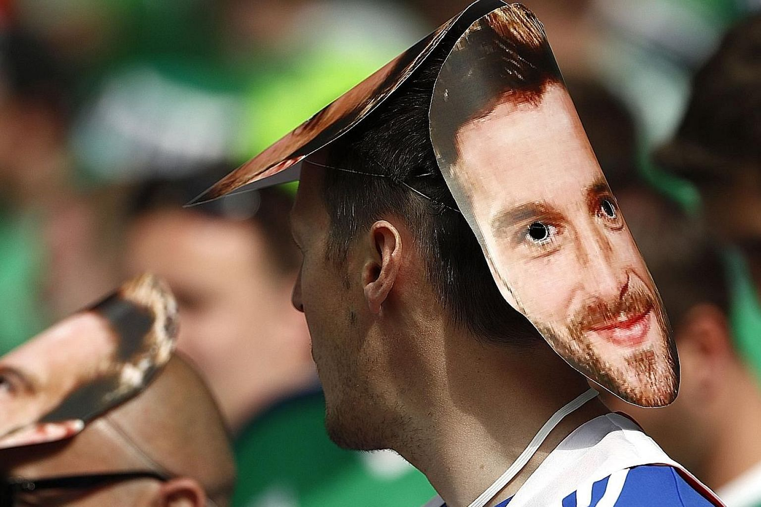 A fan with a mask of Northern Ireland forward Will Grigg waits patiently for the start of the Euro 2016 Group C encounter between Ukraine and Northern Ireland on June 16. Grigg, who has not played so far in the tournament, is the subject of a popular