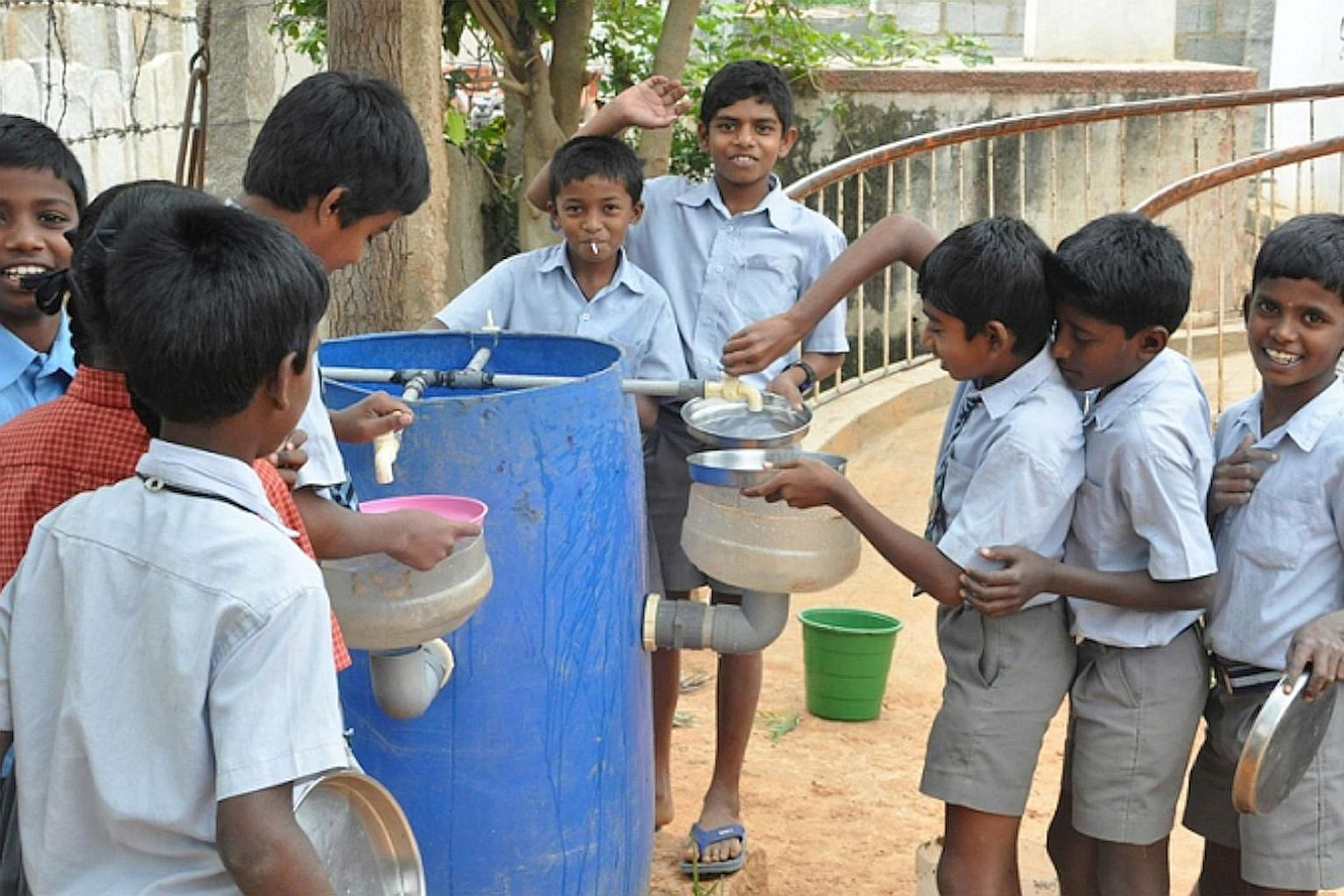 Children at the Muthur government school in India with a Reap Benefit low-cost device designed to re-use grey water so as to address the problem of water shortages. Reap Benefit gets schoolchildren to initiate innovative, actionable solutions to Indi