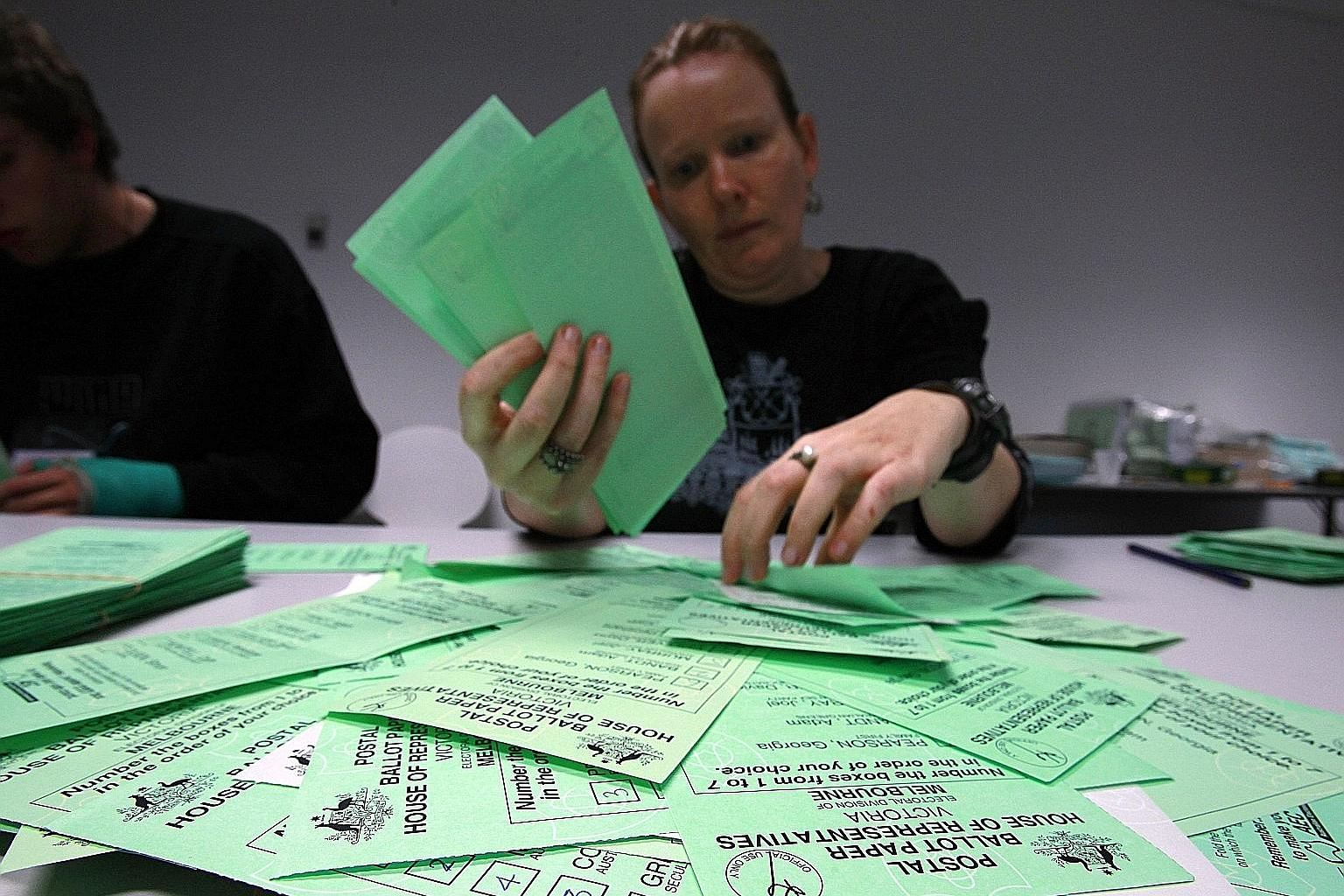 Ballot papers at an Australian Electoral Commission office in 2010. New rules put in place by the ruling coalition will try to prevent smaller parties from winning seats by swopping their unused votes with other parties.