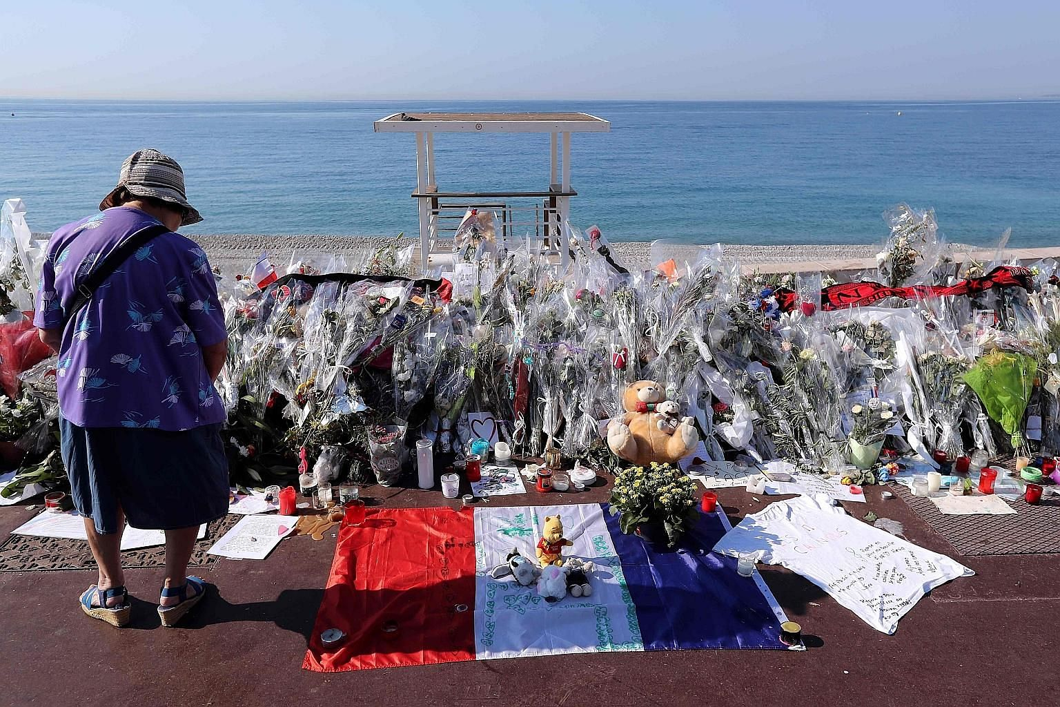 The new site yesterday of the makeshift memorial to the victims of the deadly Bastille Day attack in Nice after it was moved from the road pavement to the seafront so that the street can be re-opened.