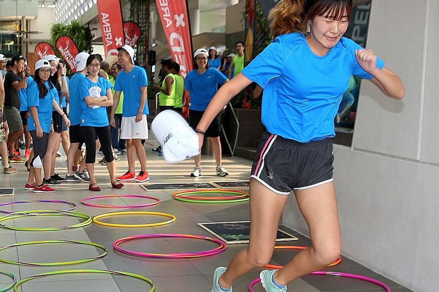 A participant trying out one of the PlayStreets games - a creative and cultural fitness scheme run by the Singapore Wellness Association and endorsed by the Active Enabler programme.