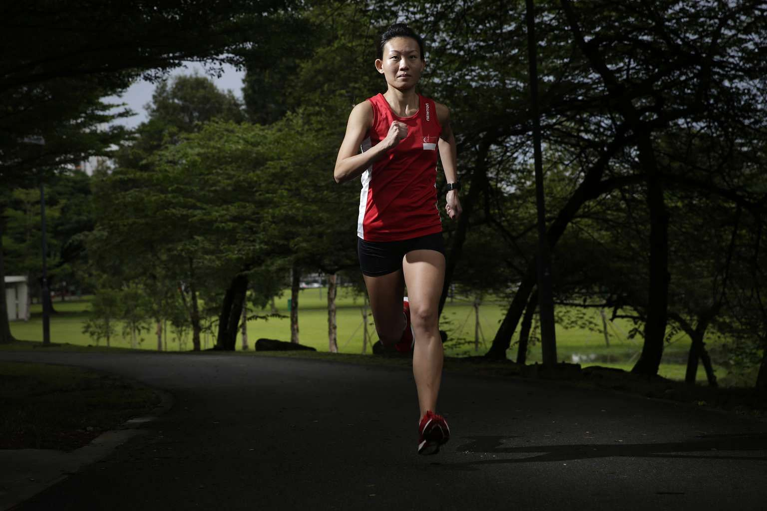 Neo Jie Shi, a marathoner for the Olympic Games, runs in a park near Jurong SAFRA where she trains. She is the first female marathoner since Yvonne Danson at the 1996 Atlanta Games.