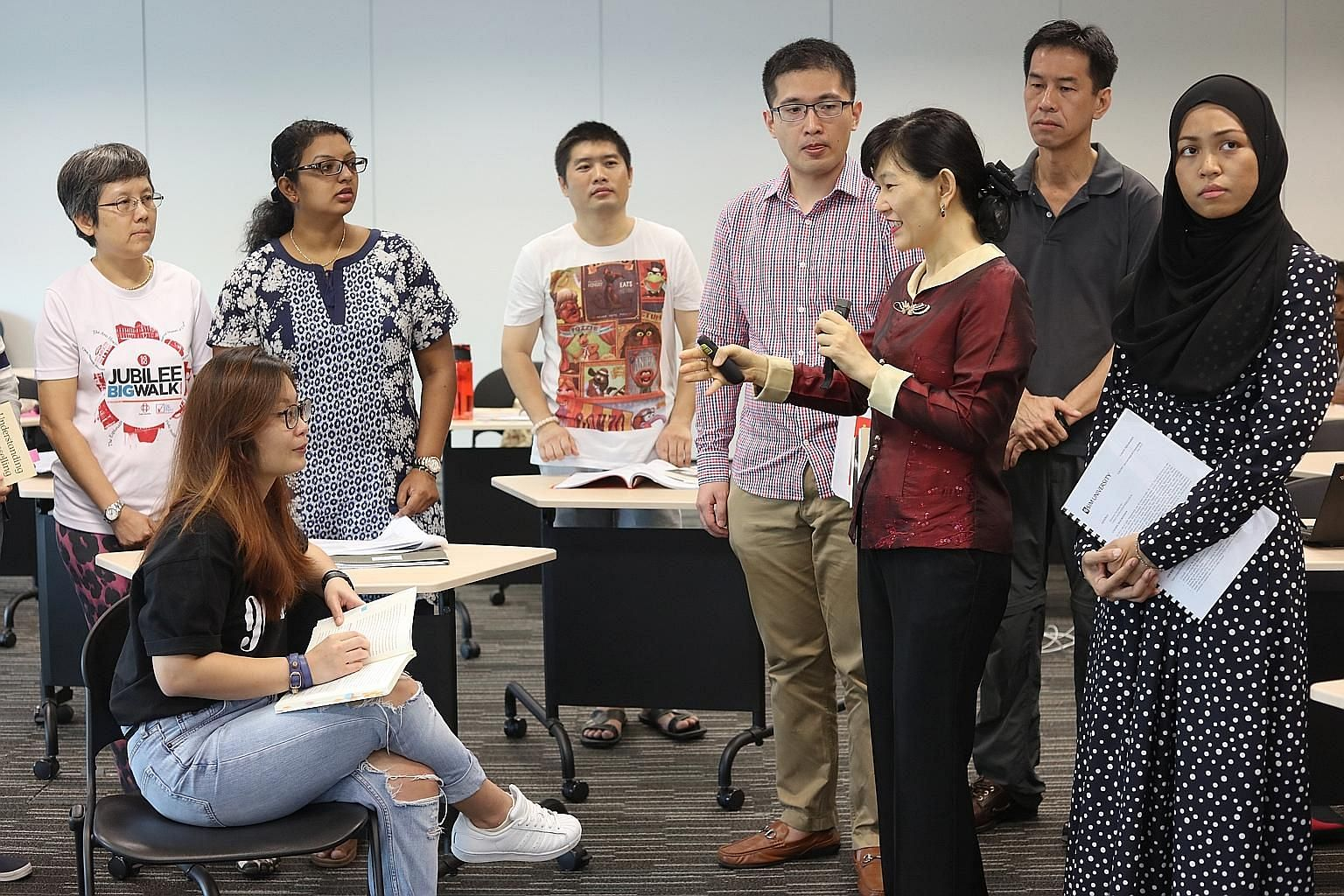 In Dr Helen Ko's (in red) Gerontological Counselling class at UniSIM, many of the students are in their 30s and 40s.
