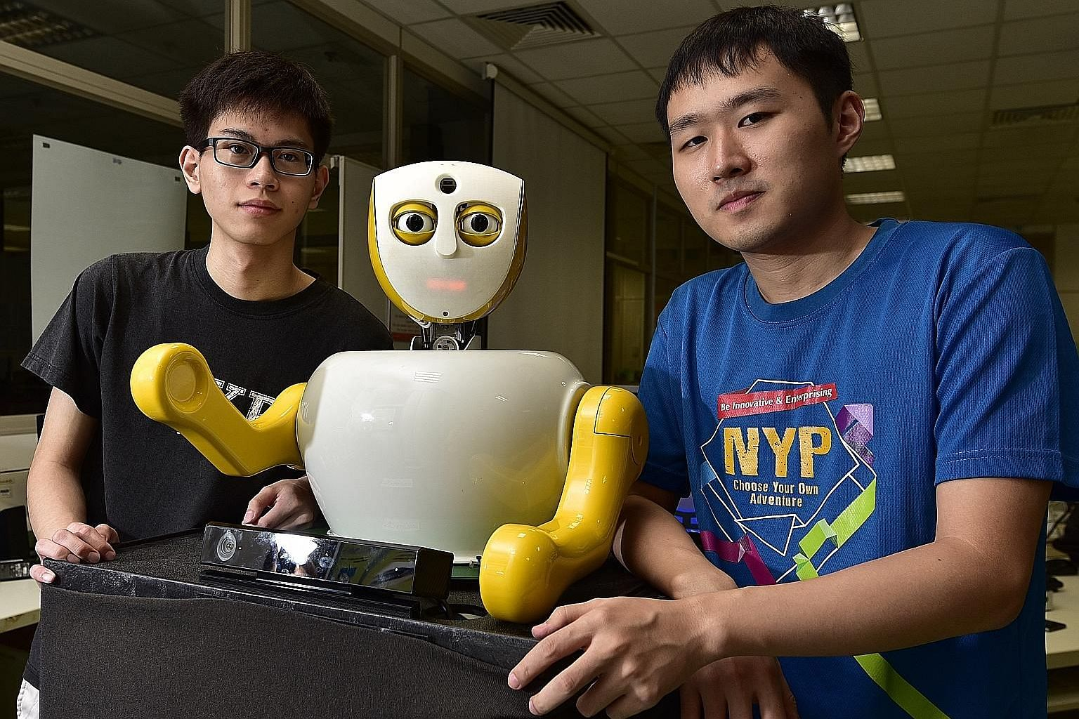 Mr Francis Swee, 20 (left), and Mr Yu Zhigang, 22, with Ruth. The two students from Nanyang Polytechnic make up half of Team Yuuy, which came up with Singapore's newest social robot. Ruth is designed to act like a human being and intended to eventual