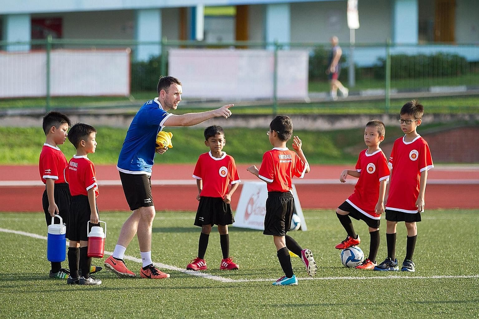 Mr Kenneth McGeough is one of the 20 volunteers with the Play It Forward initiative. A former Under-21 player with Irish top-tier team Shamrock Rovers, he coaches children under 12 in football at the Queenstown Stadium.