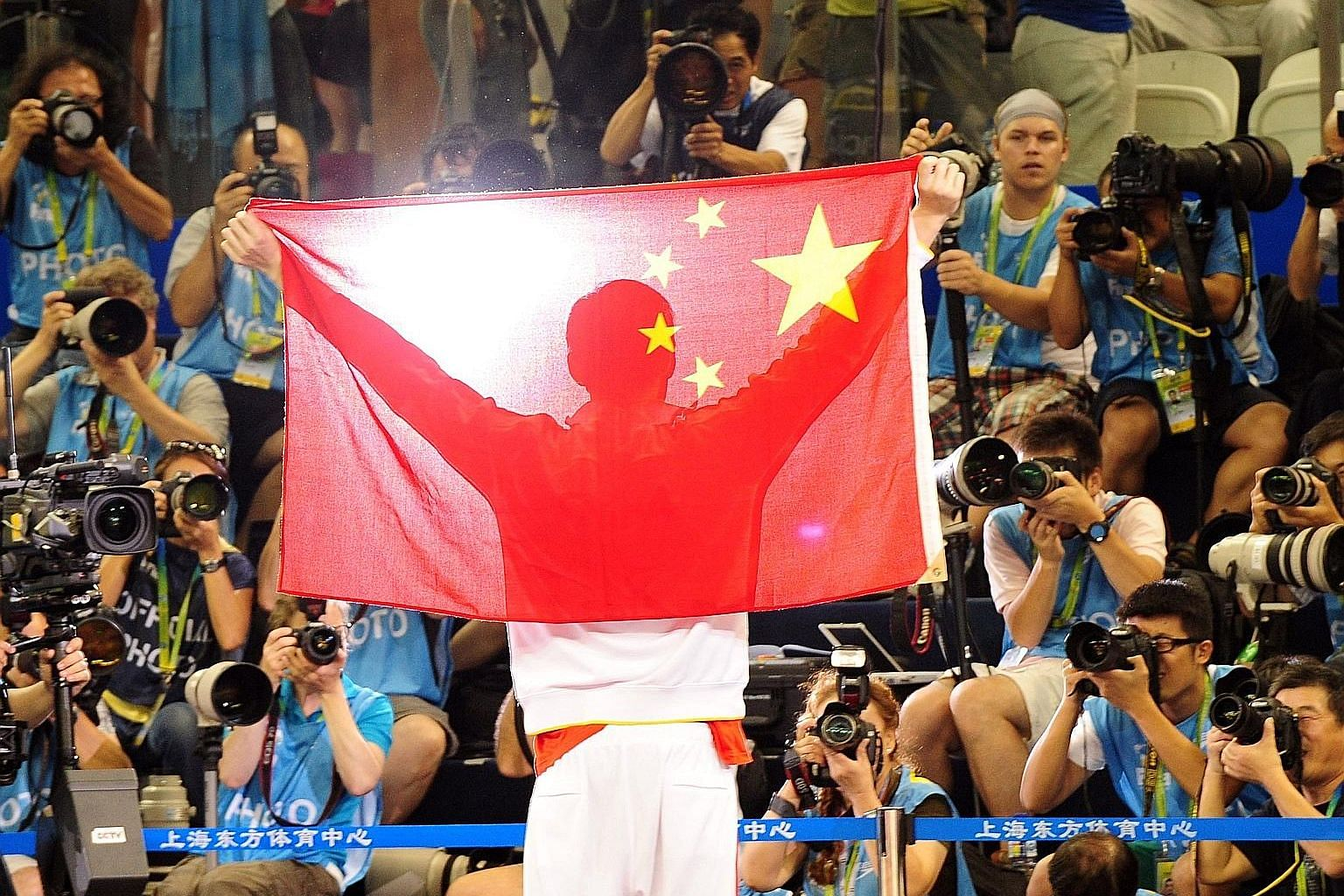 Above and top, left: The controversy over the Chinese flags being used at the Rio Olympics revolves around the orientation of the four small stars on the flags and the way in which they should be placed in relation to the main star.