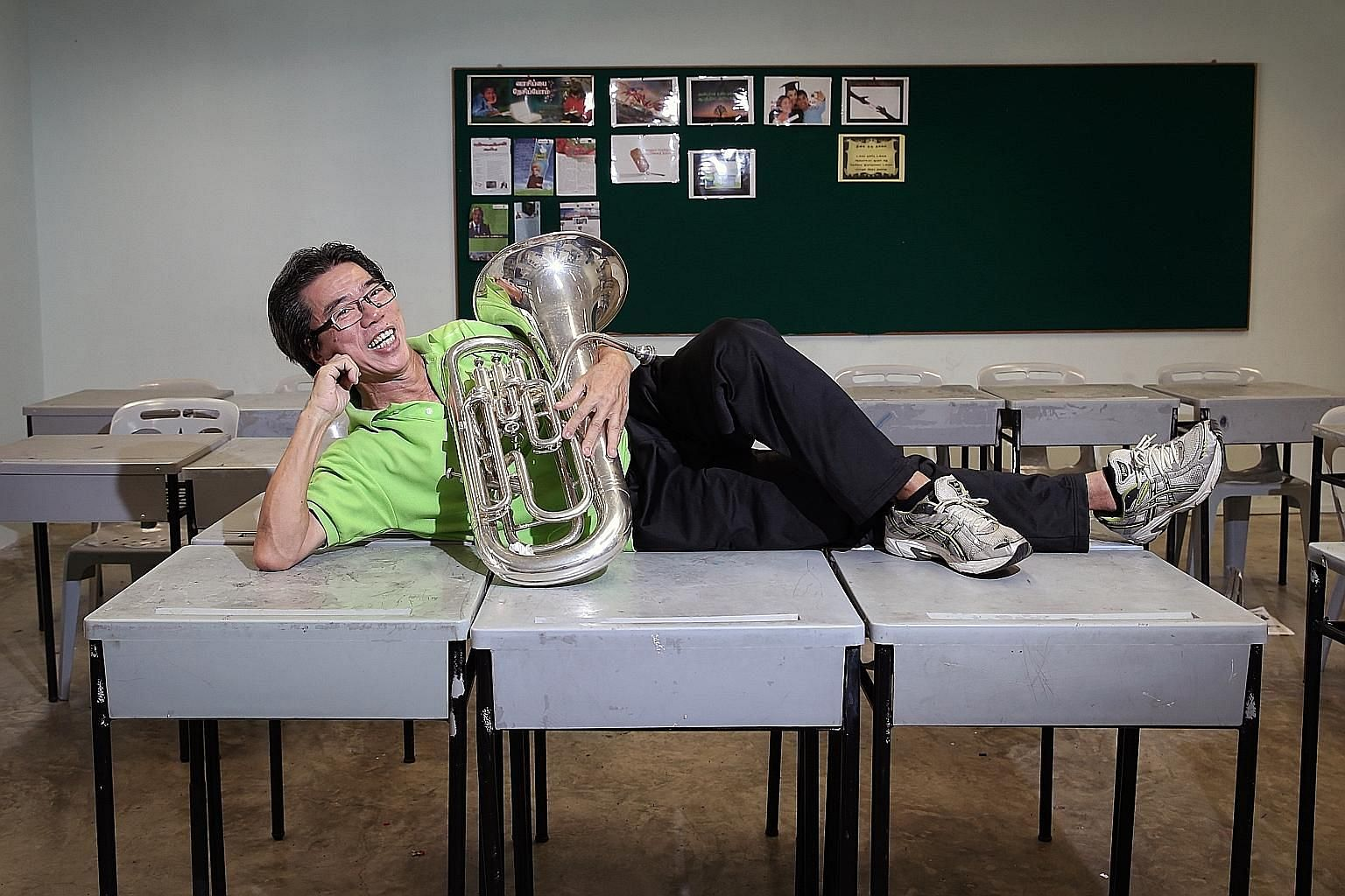 Mr Chiang with a baritone horn - the instrument he played at the 1966 National Day Parade - in St Gabriel's Secondary School. To ensure punctuality, he and others had stayed overnight at the school and slept on tables. A then 15-year-old Bernard Chia