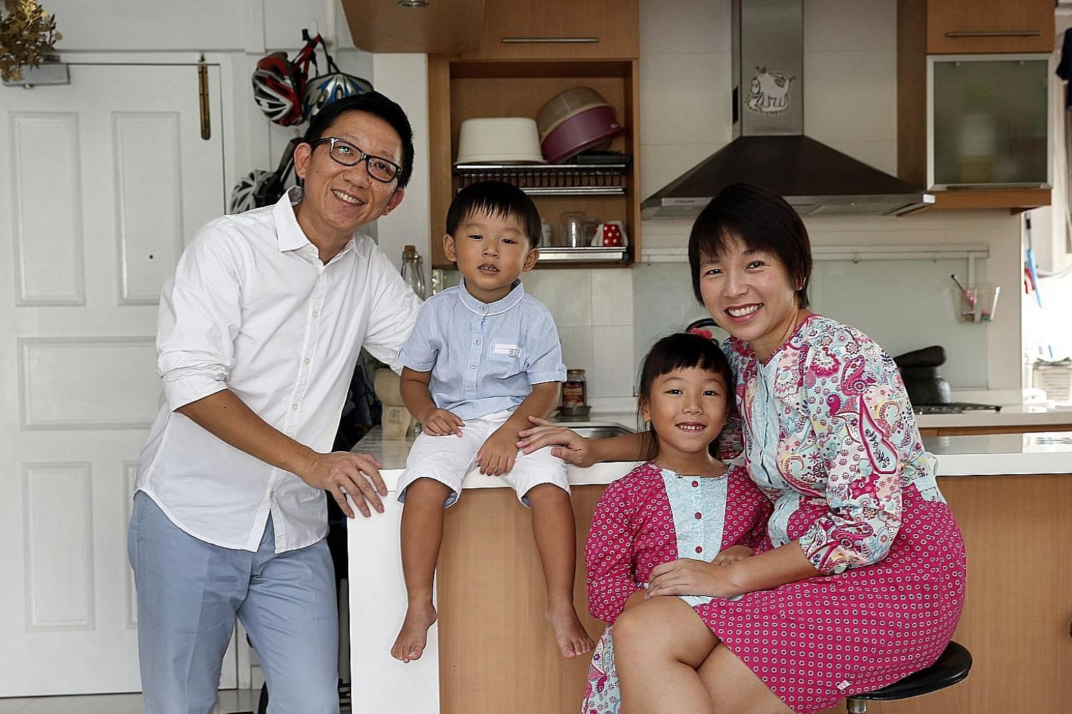 Mr Jeffrey Png and his wife Wong Tze Wei, with their children Oliver, three, and Amelie, six.