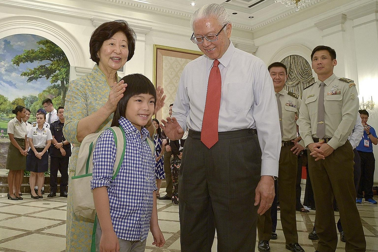 President Tony Tan Keng Yam and his wife Mary with the boy who made heads turn at this year's National Day Parade when he rode a unicorn that appeared to gallop through the air. Minejima-Lee Kai, seven, a pupil of Stamford American International Scho