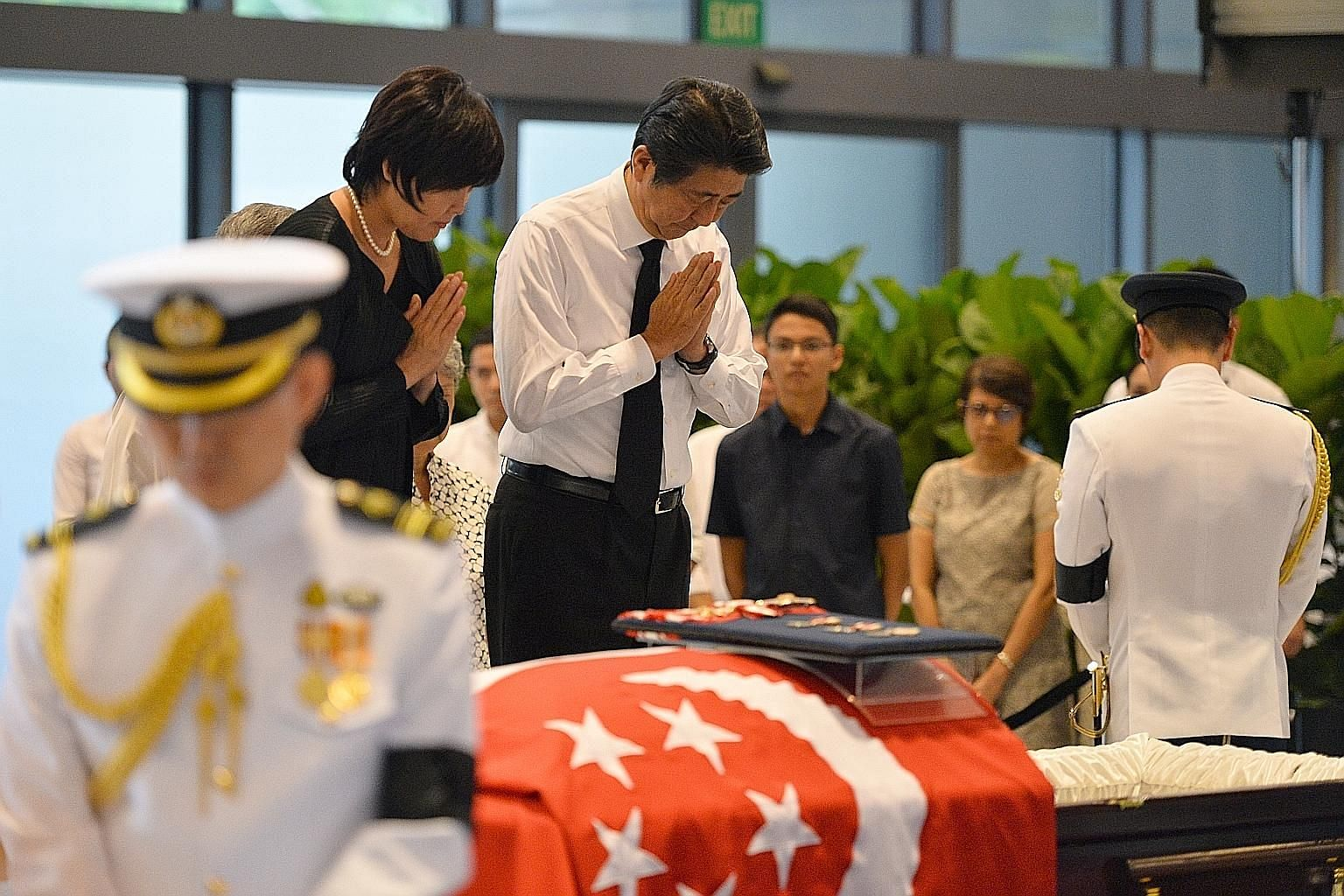 "Mr Abe and his wife Akie paying their last respects to Mr Nathan at Parliament House yesterday. In a condolence message, the Japanese Prime Minister described him as a ""cornerstone of unity"" for Singaporeans."