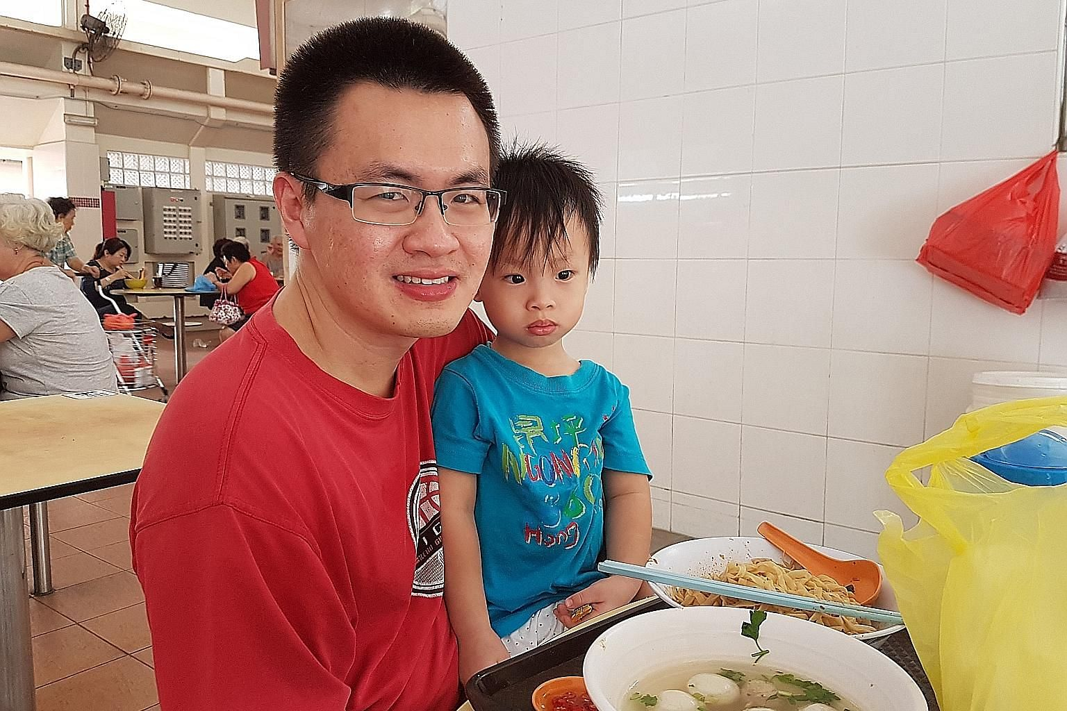Mr Tan Kok Soon with his three-year-old son Jarrell Tan. The Bedok North Avenue 3 resident is not taking any chances even though Zika is not known to have a serious impact on young children. He makes sure his three children apply repellent before goi