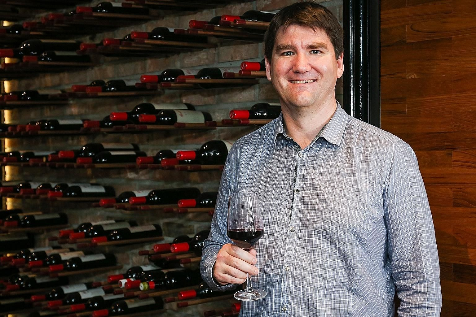 Penfolds wine-maker Adam Clay with a glass of shiraz from the Max's label of wines, targeted at young drinkers.