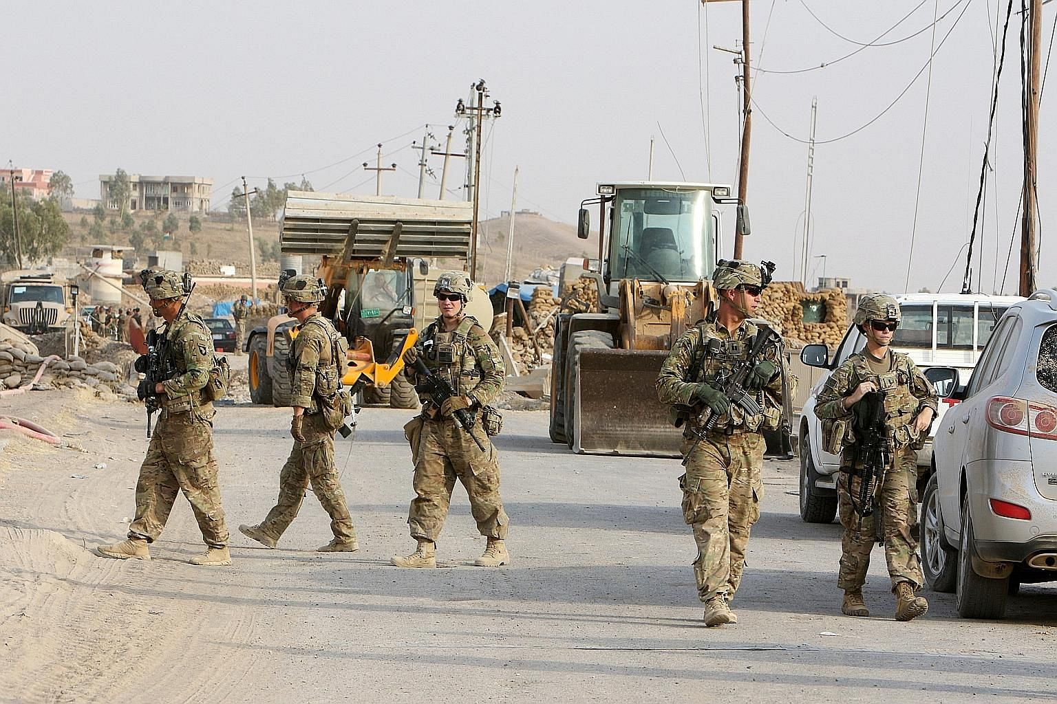 US soldiers in Iraq last month. American officials say that although they are confident ISIS will be defeated on its Iraq-Syria turf eventually, that will not end the overall extremist threat.