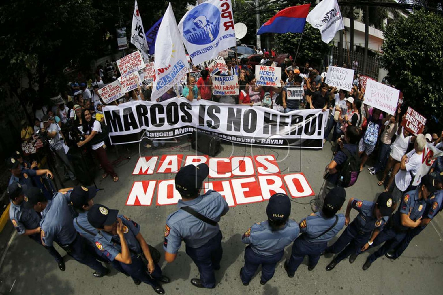 Protesters who oppose giving Marcos a hero's burial gathered last month outside the Supreme Court in Manila where petitions seeking to bar his interment at the Heroes' Cemetery were being heard.