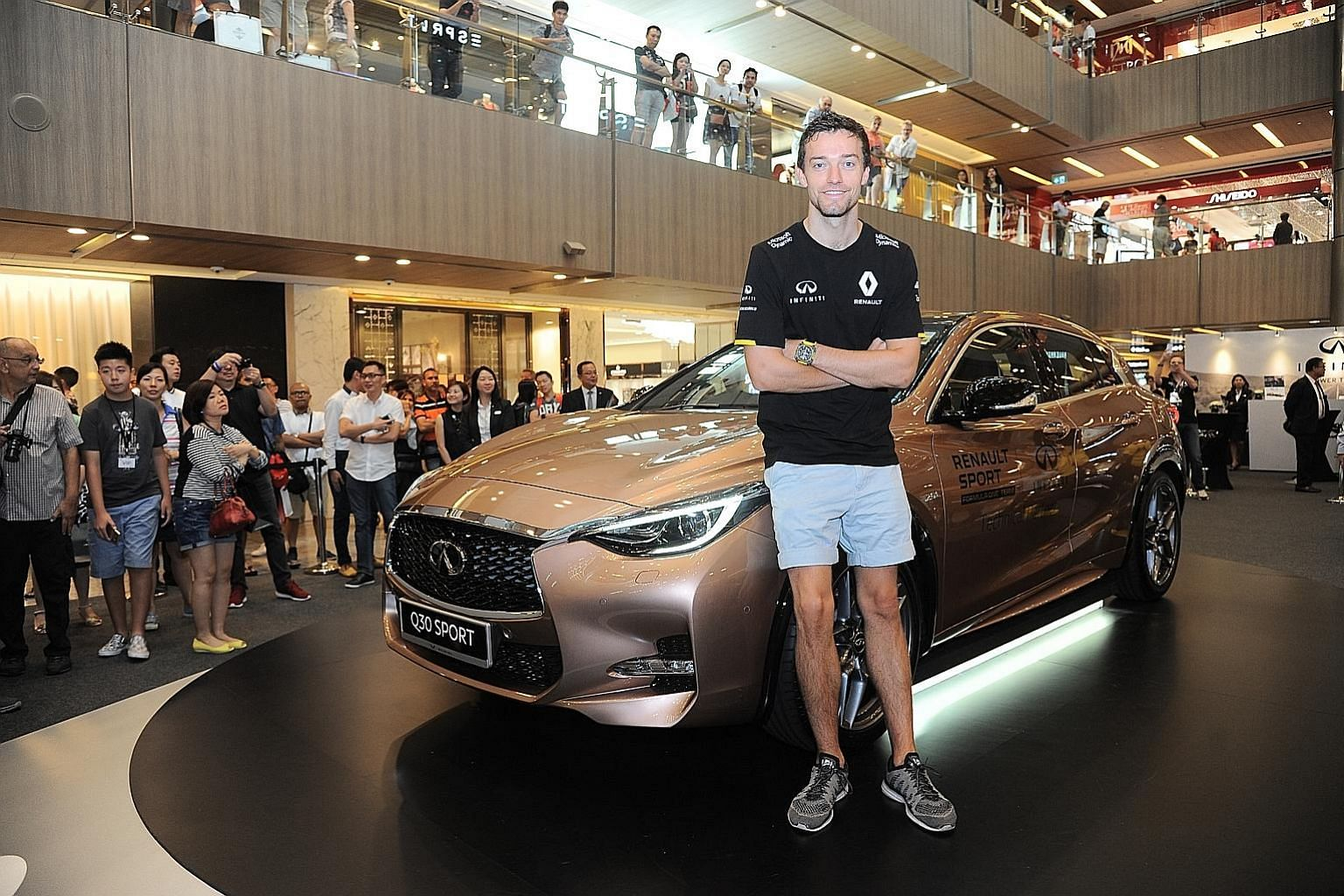 Renault's Jolyon Palmer with the newly launched Infiniti Q30 at a roadshow at Paragon. Having driven and now raced at the highest level, the Briton aims to one day mount the podium, win a race or even the title.