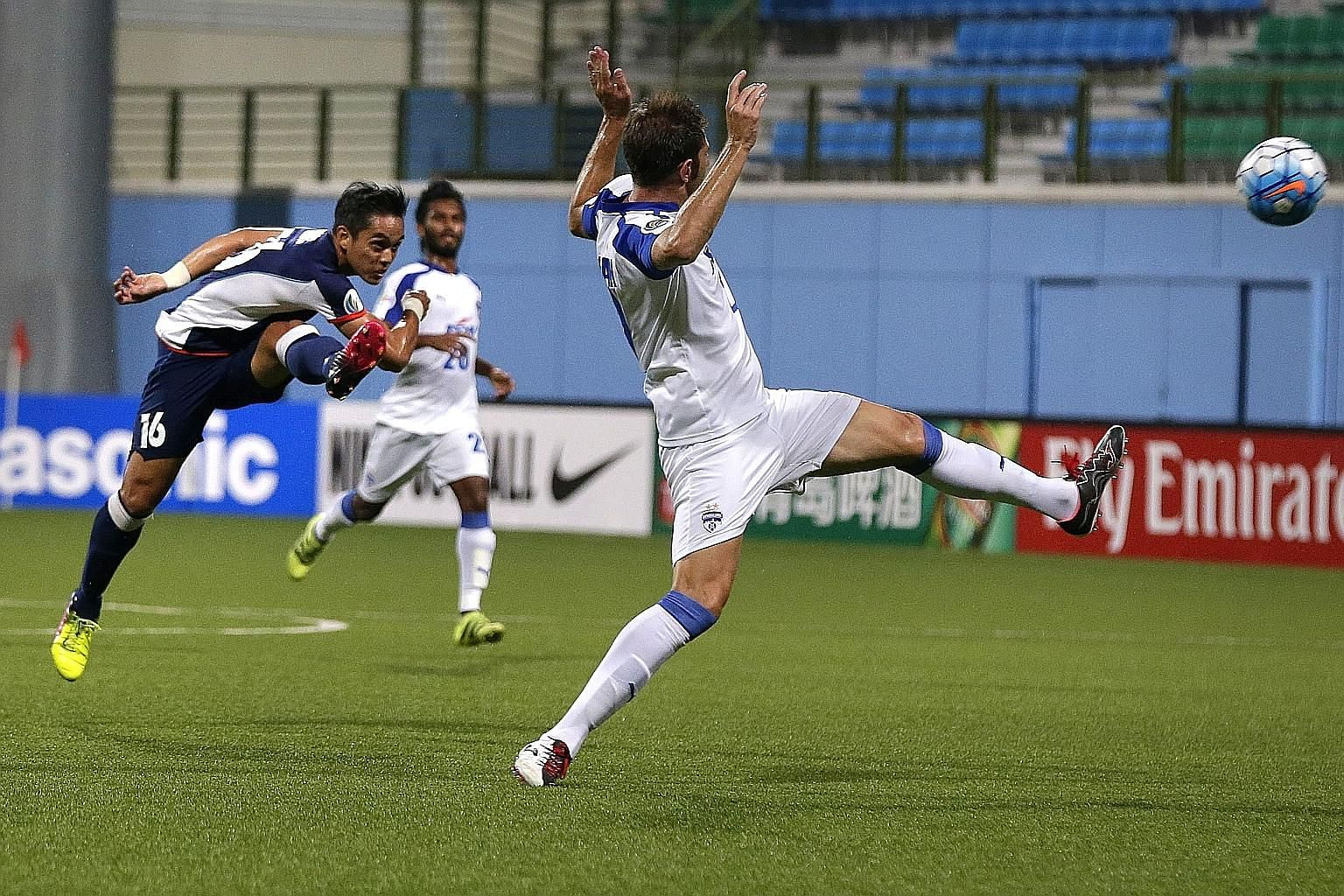 Tampines Rovers midfielder Hafiz Sujad shooting past Bengaluru FC's Juan Antonio during their AFC Cup stalemate. The Stags were knocked out after failing to score over two legs.