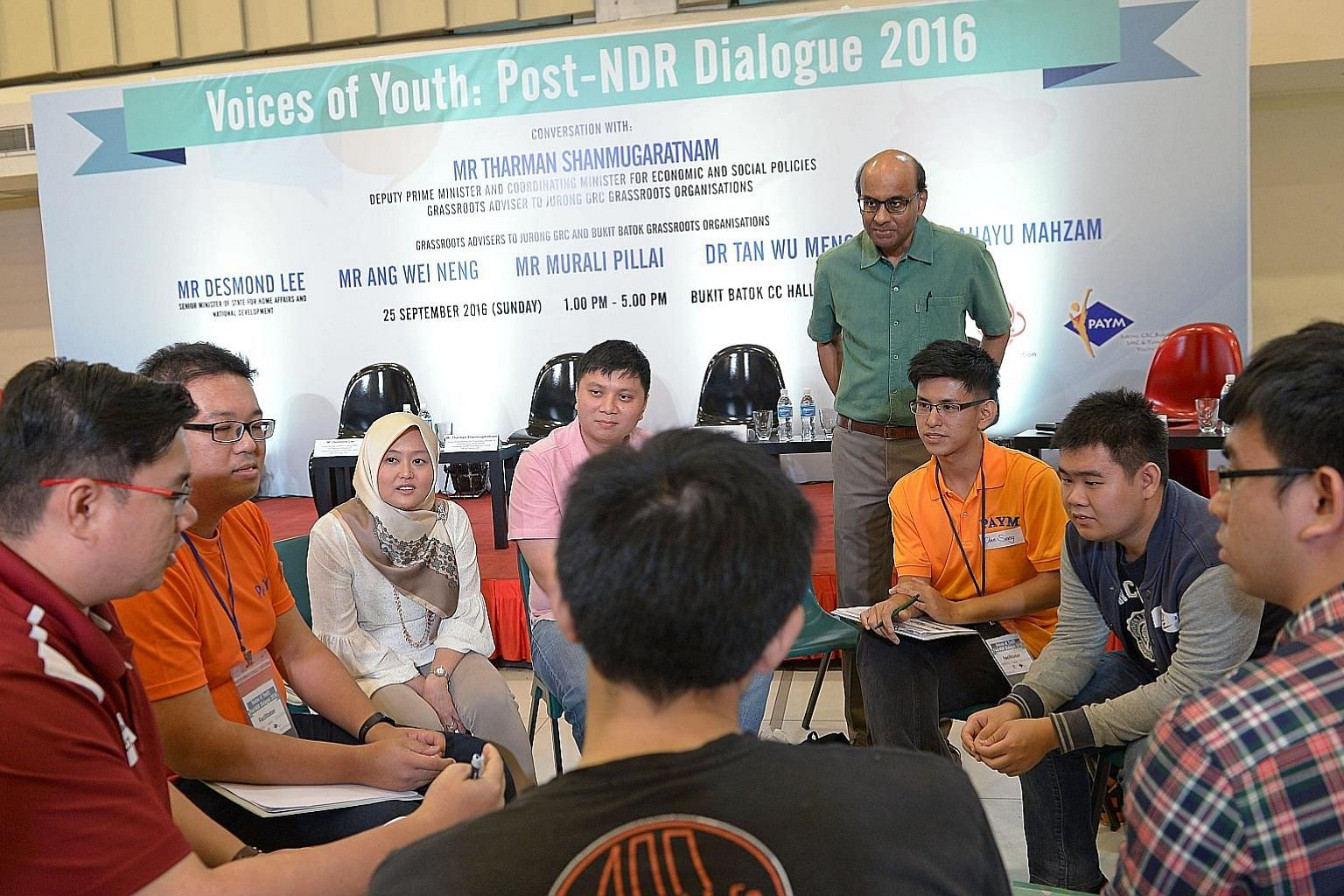 Mr Tharman and Jurong GRC MP Rahayu Mahzam (third from left) at a small group discussion with young people yesterday. After the discussions, participants took part in a dialogue with MPs from Jurong GRC and Bukit Batok, where they discussed issues ra