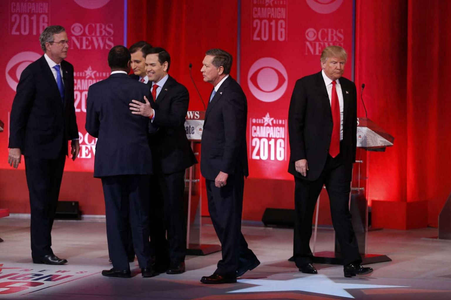 Mr Trump (far right) walking off the stage alone as his former rivals - (from left) Mr Jeb Bush, Dr Ben Carson, Senator Ted Cruz, Senator Marco Rubio and Governor John Kasich - gathered after a Republican presidential candidate debate in February. Mr Kasi