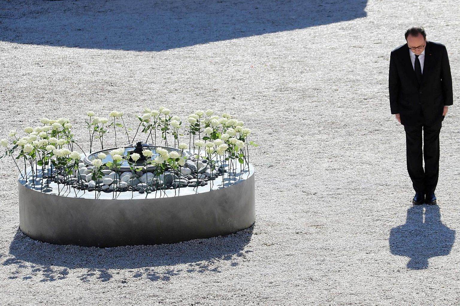 French President Francois Hollande yesterday in Nice during a tribute to the Bastille Day terror attack victims. The white roses represent the 86 people who died on July 14.
