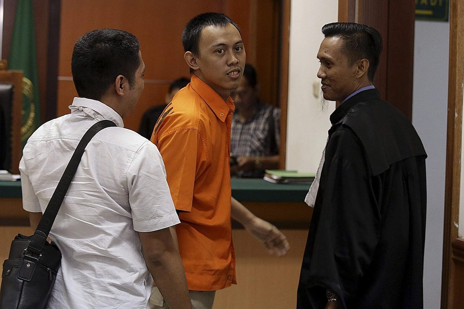 "Dodi Suridi (in orange) said after his sentencing yesterday that he accepted the punishment and that ""this is the risk of being a terrorist""."